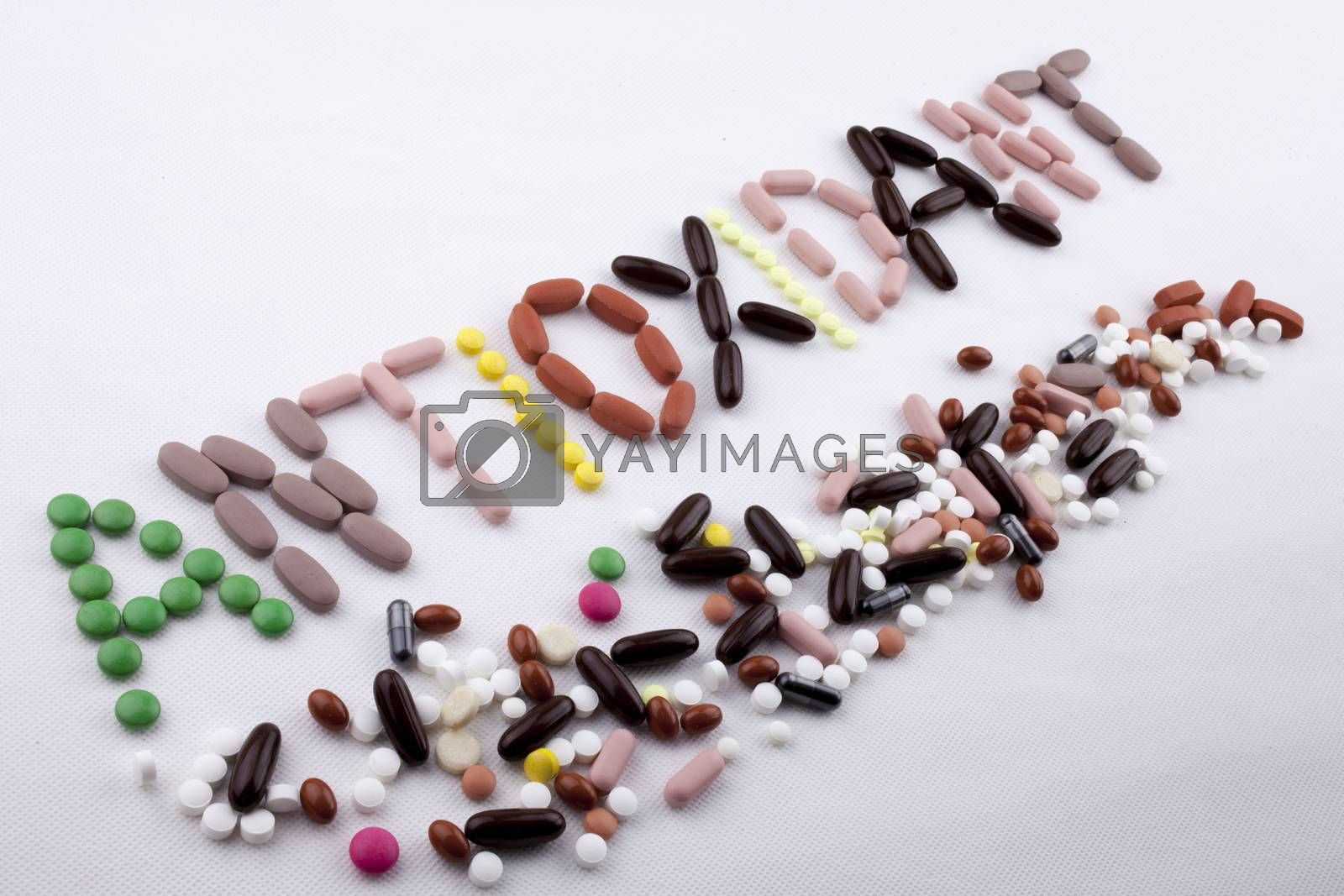 Hand writing text caption inspiration Medical care concept written with pills drugs capsule word Antioxidant On white isolated background with copy space by Artur Szczybylo