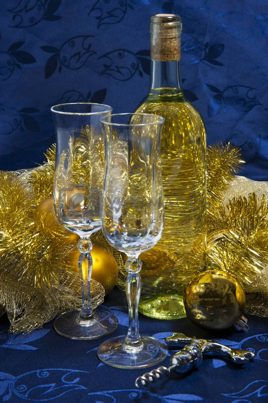 Bottle of white wine, glasses and Christmas decorations by carla720