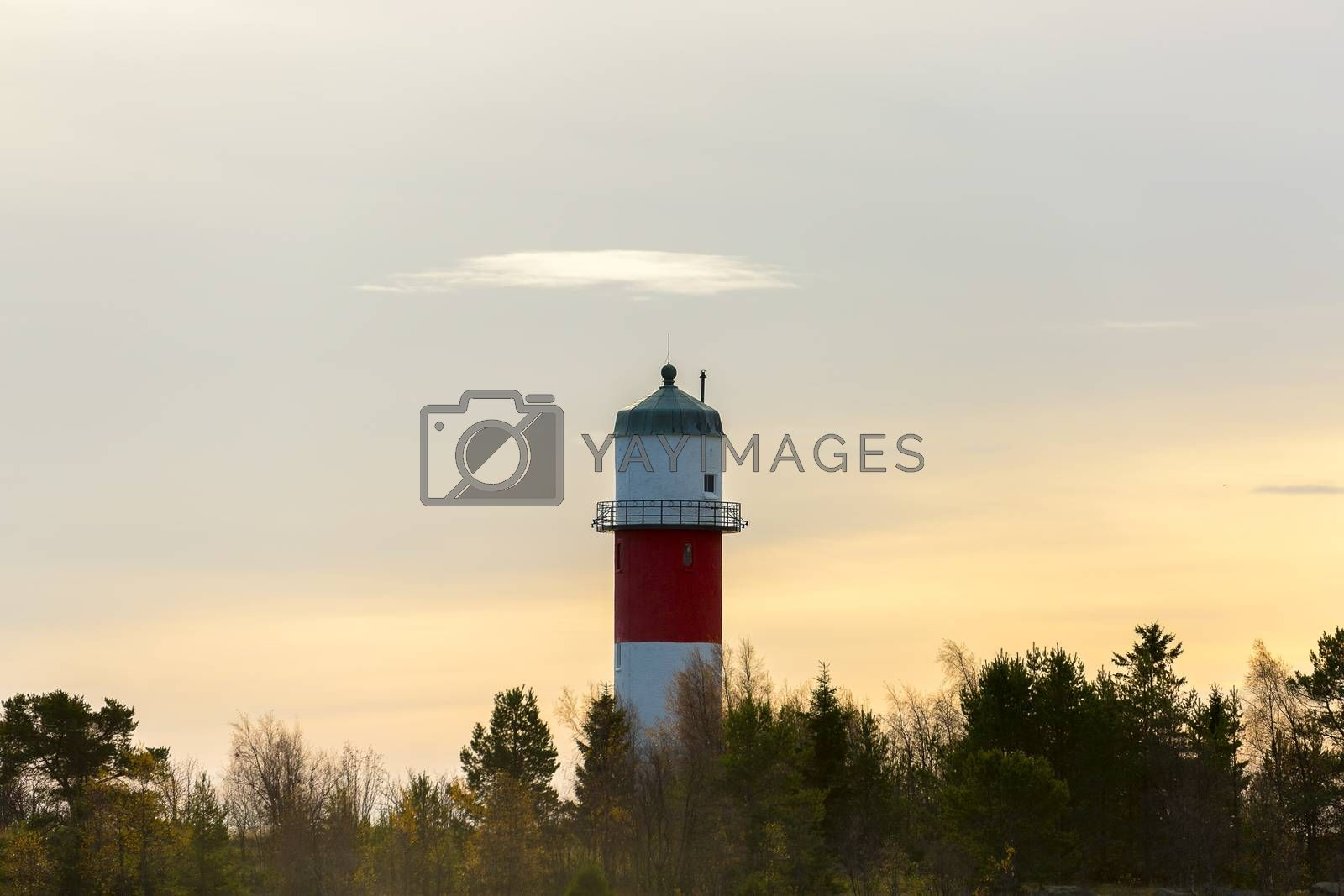 Light House in Holmsund, Sweden with a cloudy sky.
