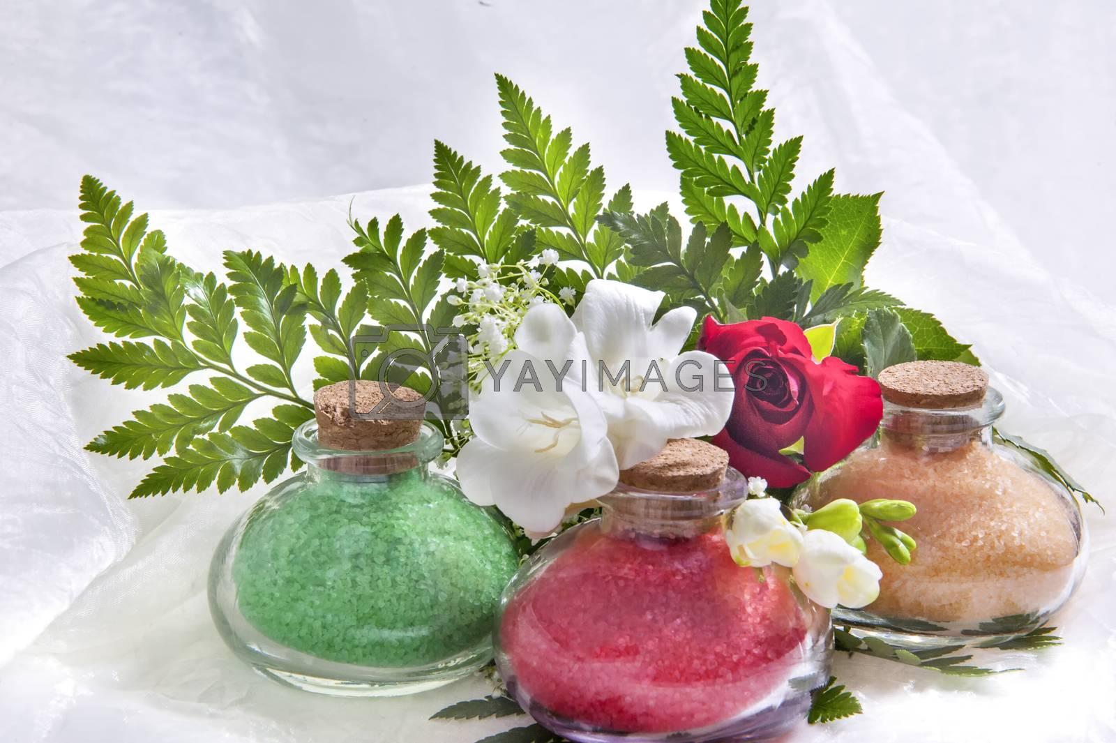 a Glass flasks containing a bath salts