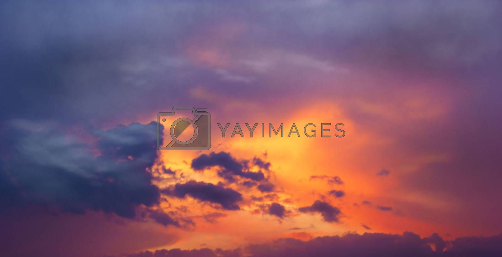 Sunset amid thunderclouds. Sunset shines red through dark clouds.