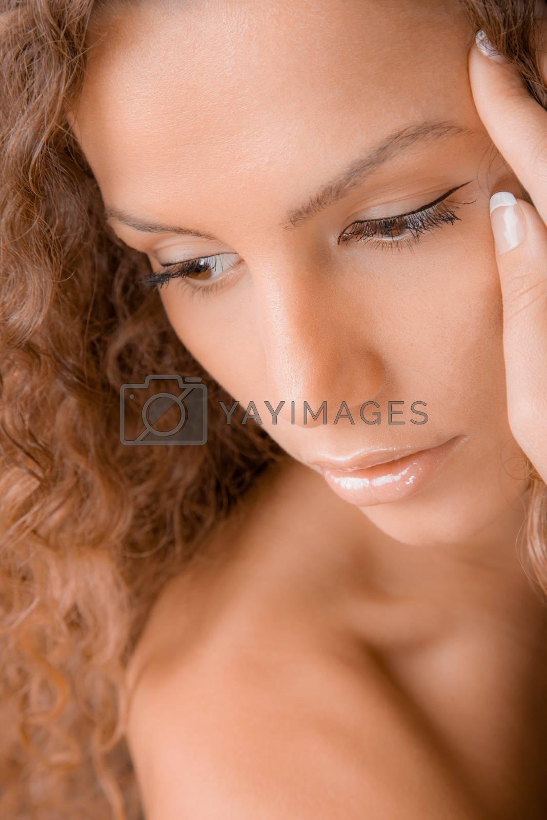 A close-up beauty portrait of a gorgeous young woman.