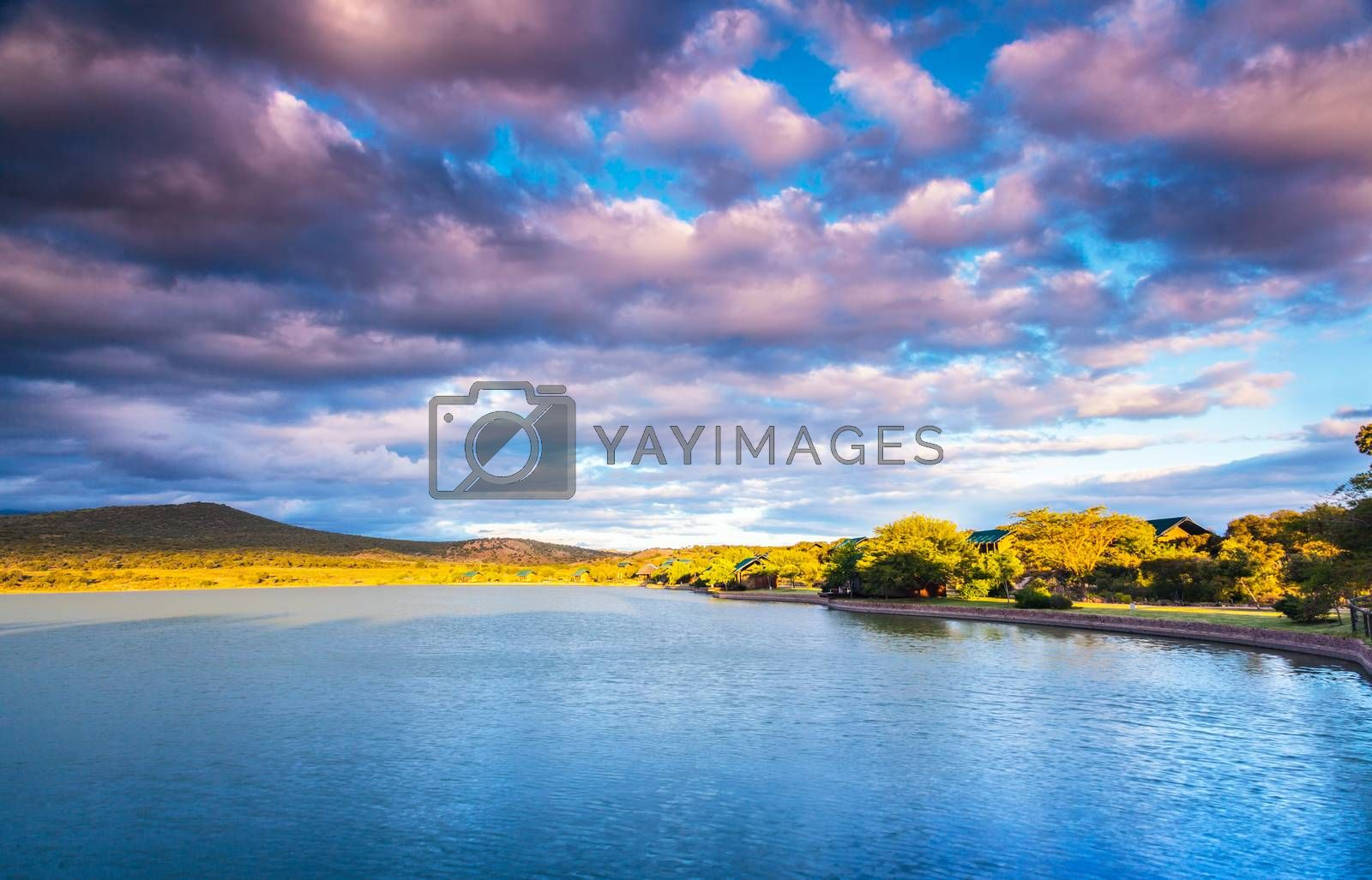 Garden Route in sunny day, beautiful landscape of a lake and mountains with fluffy clouds over it, panoramic view, amazing nature of South Africa