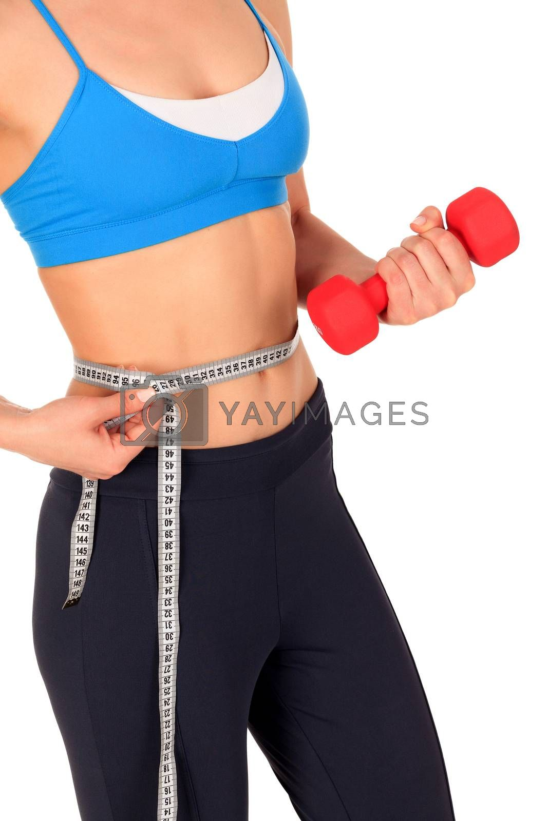 Closeup shot of slim young woman holding red dumbbell and measuring her thin waist with a tape measure, isolated on white background