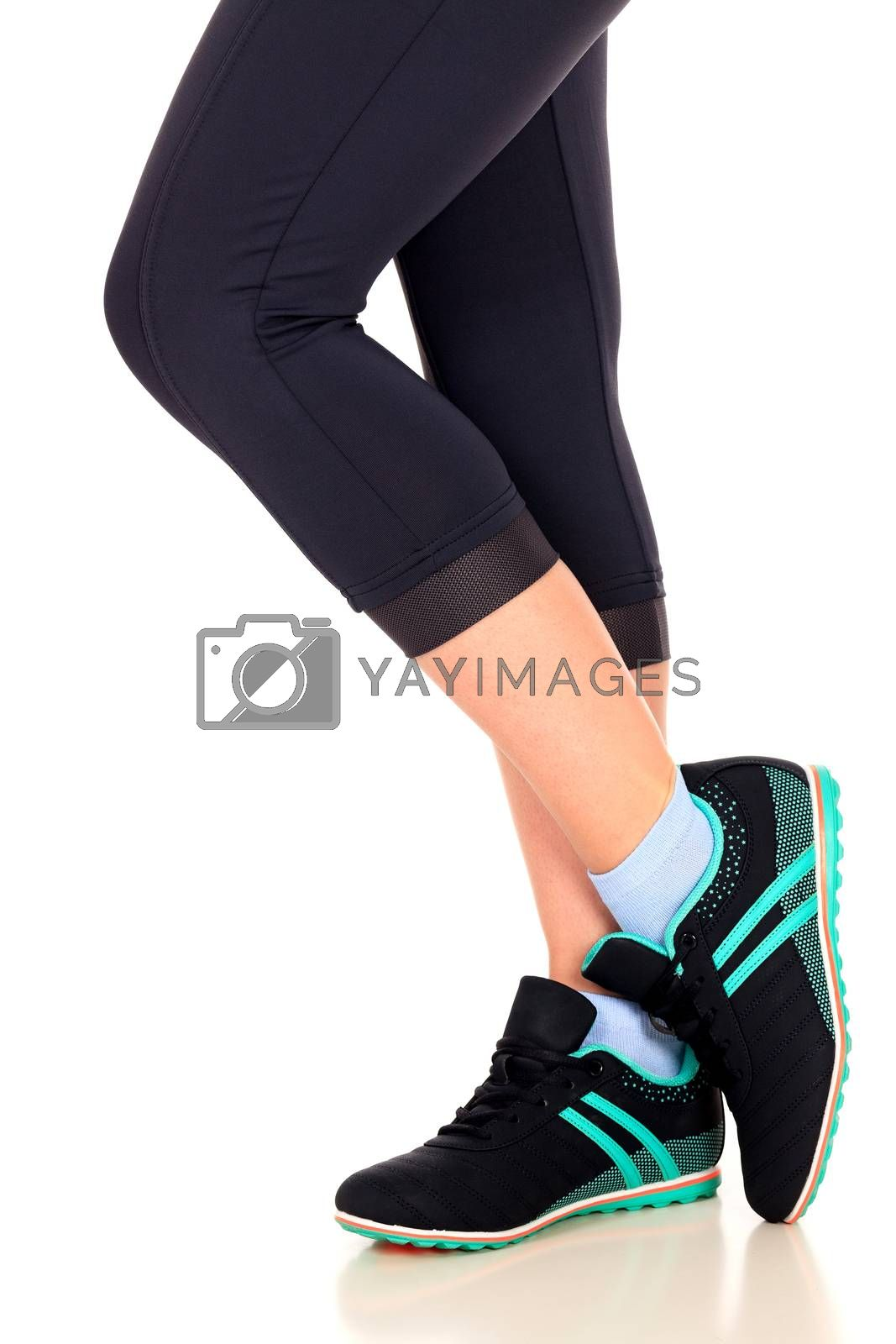 Legs of a fit woman, isolated on white background
