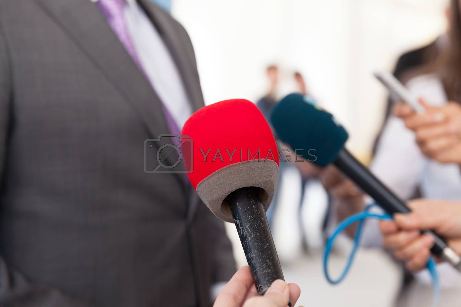 Press interview. News conference. Microphone.