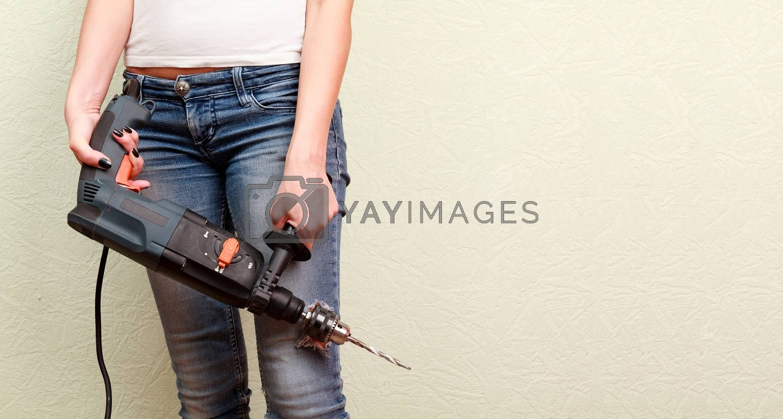 Woman holds a drill