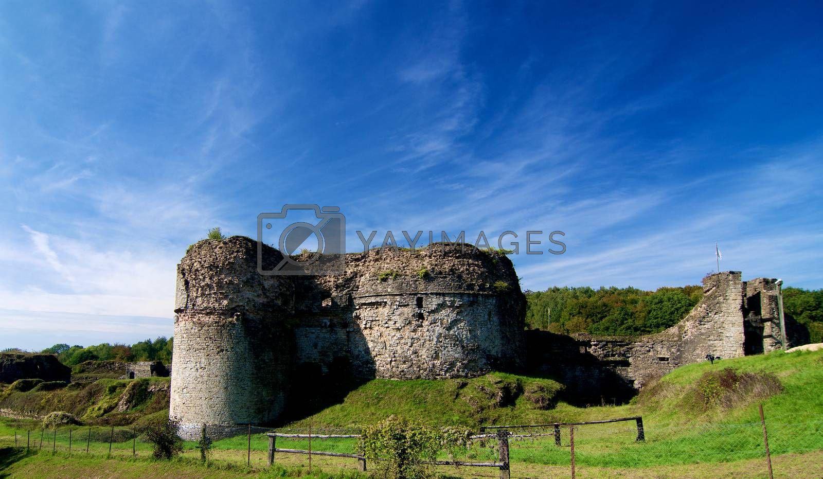 Ruins of Medieval Chateau de Montcornet against Blue Sky in Sunny Day Outdoors. Ardennes, France