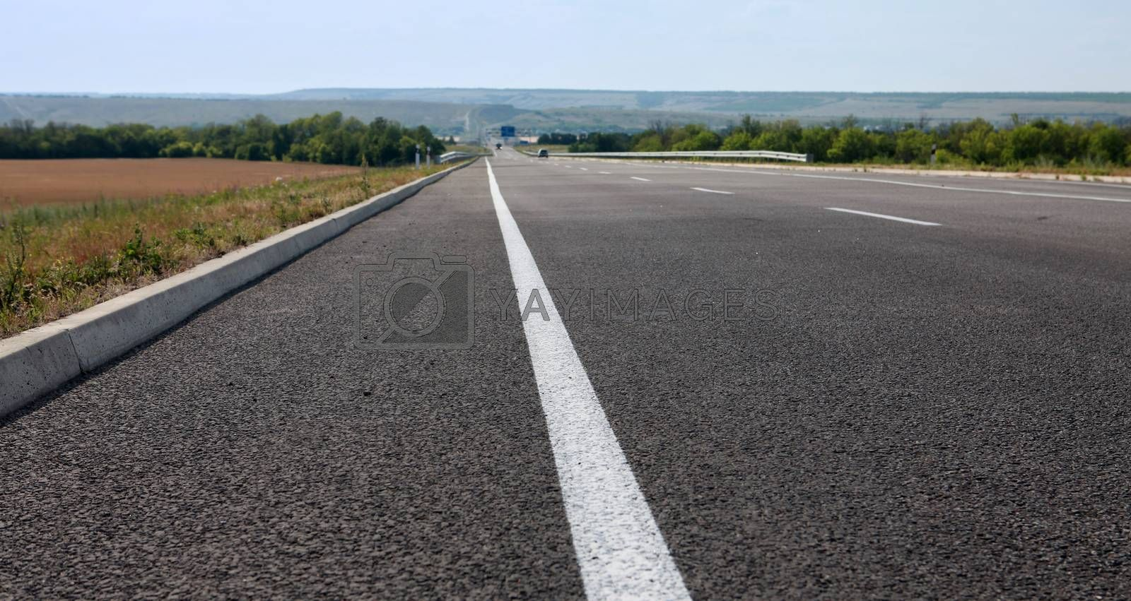 new asphalt road for fast driving at summer