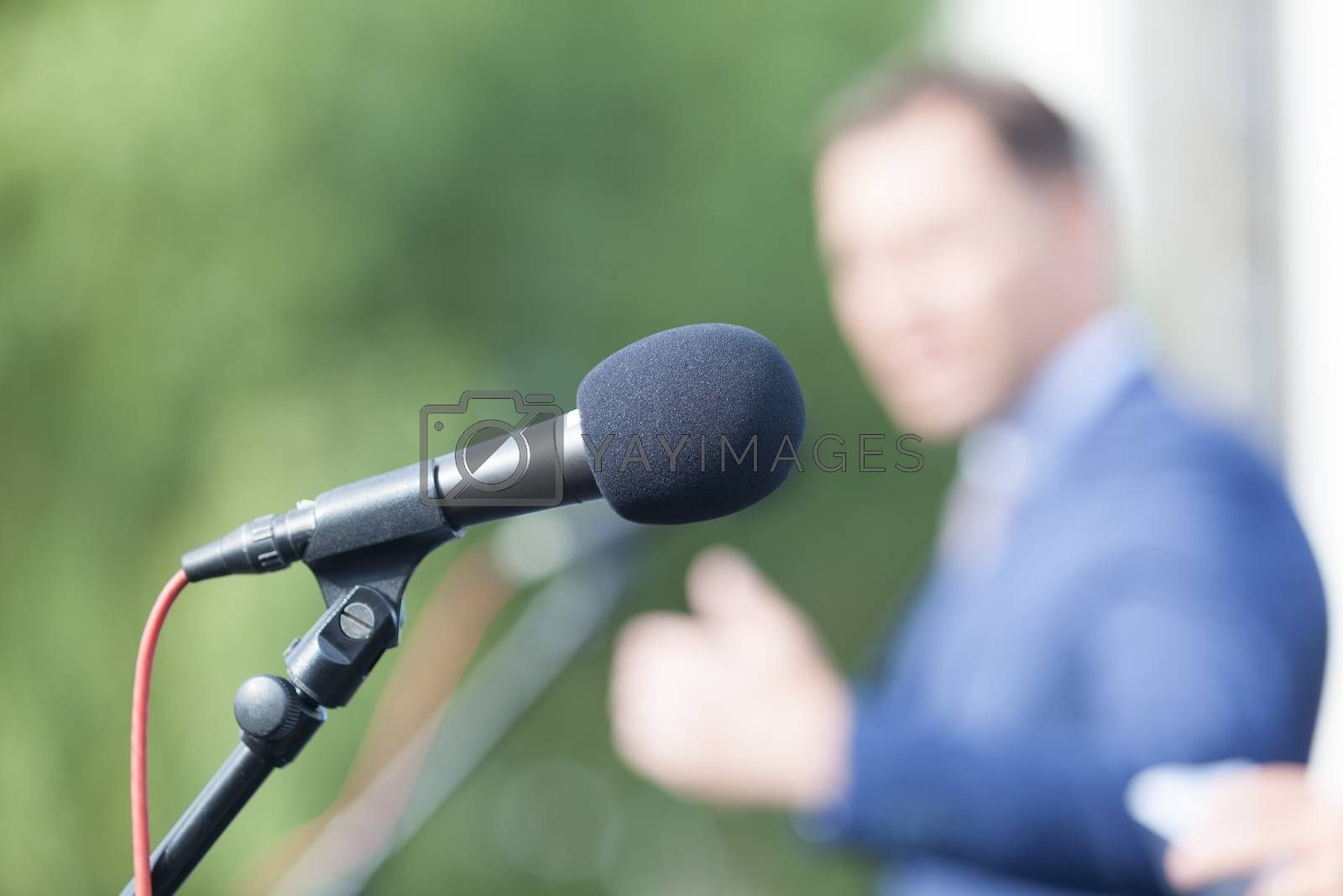 Speaker. Speech. Microphone. News conference. by wellphoto