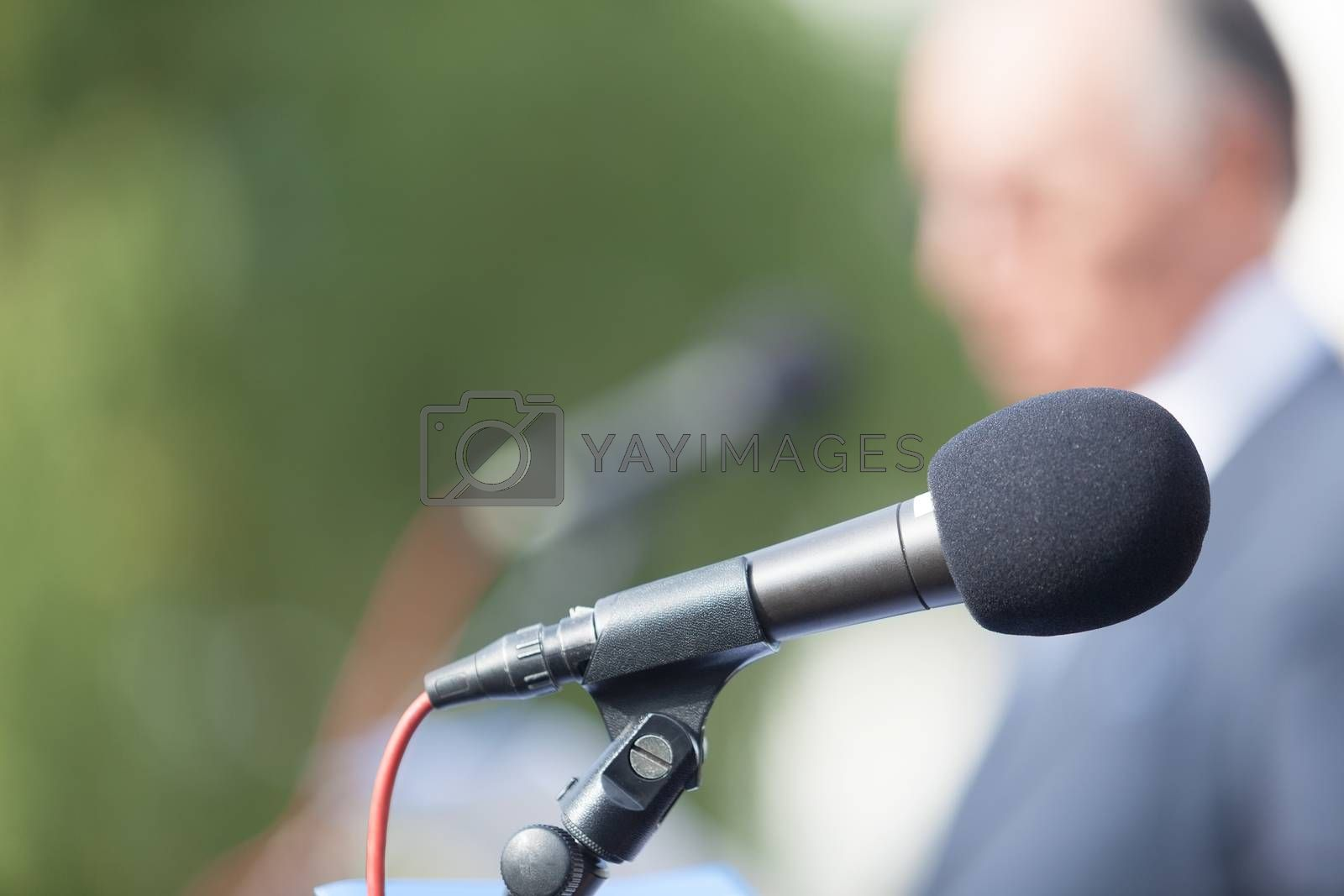 Business person or politician is giving a speech. News conference.