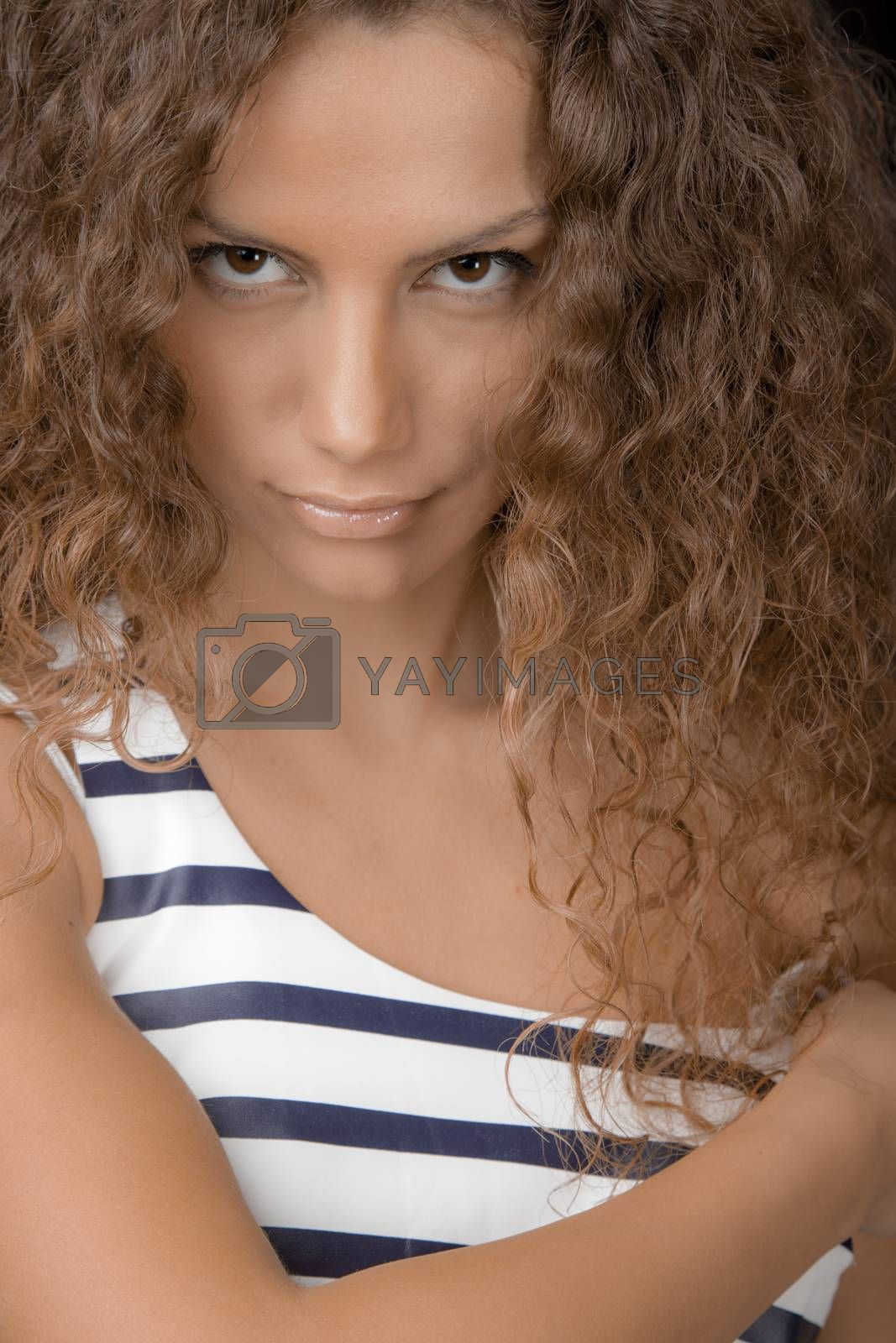 A portrait of young beautiful female looking sexy in to the camera.