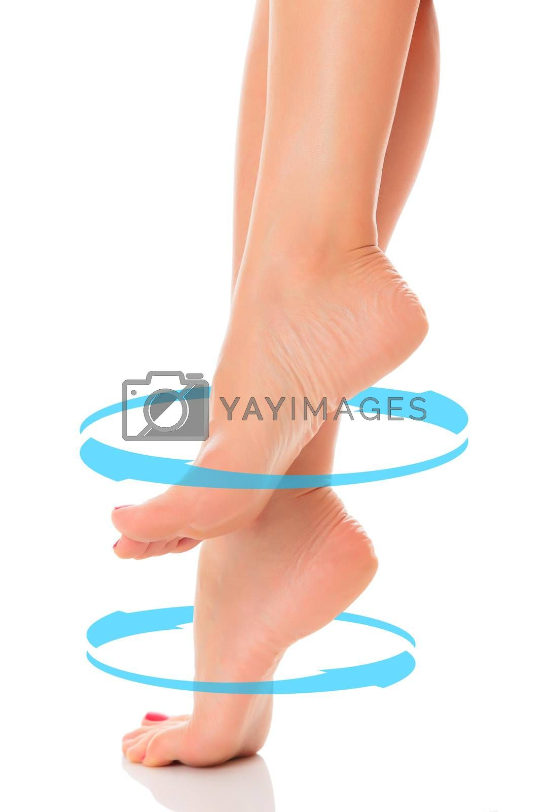 Female bare feet with blue arrows rotating around them, isolated on white background. Skincare concept