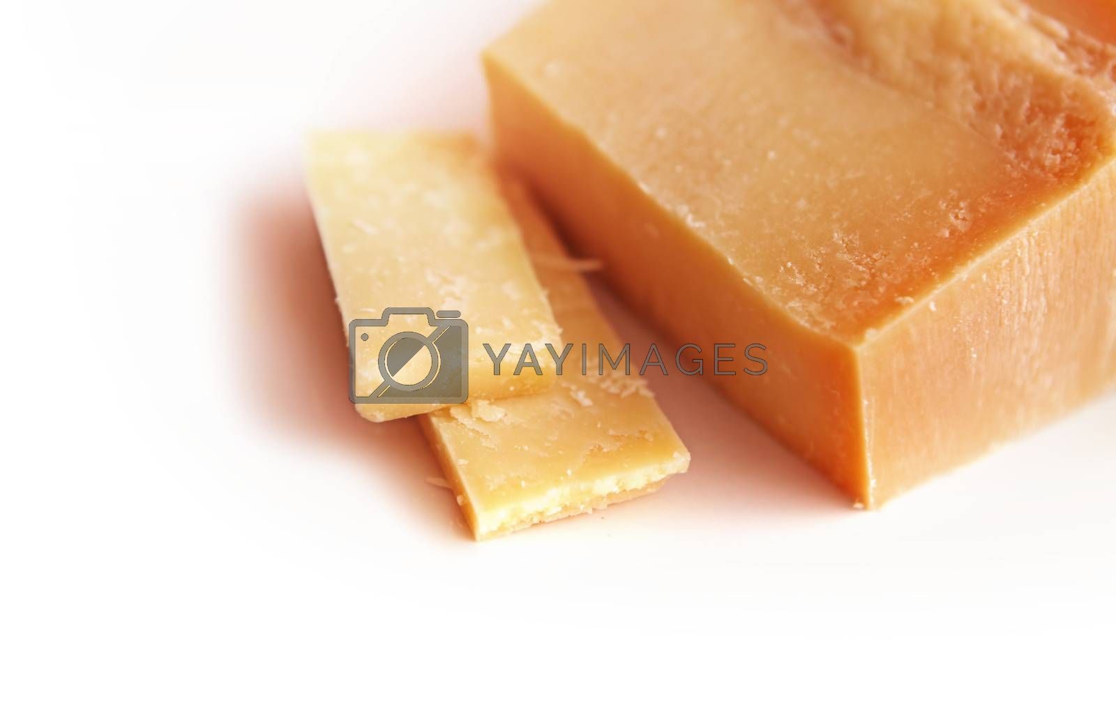 piece of Italian cheese parmesan on white background
