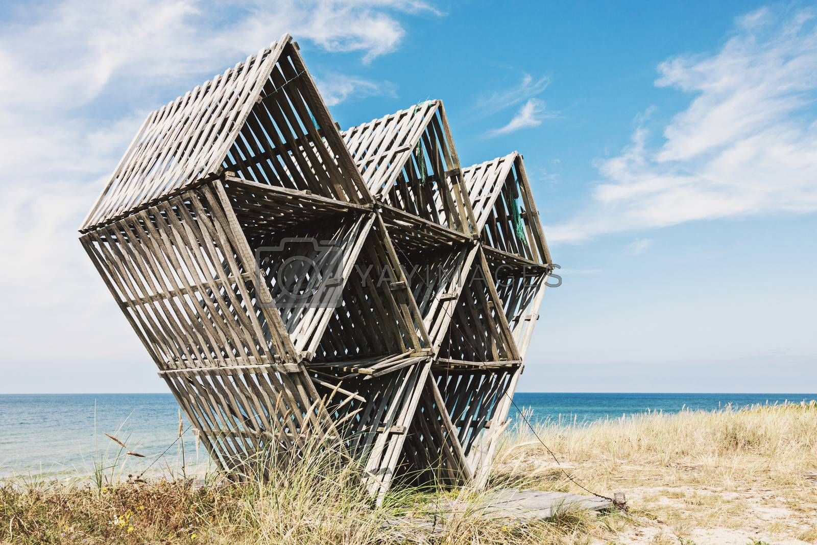 Old abandoned wooden geometric sculpture on wild beach in Juodkrante, Lithuania