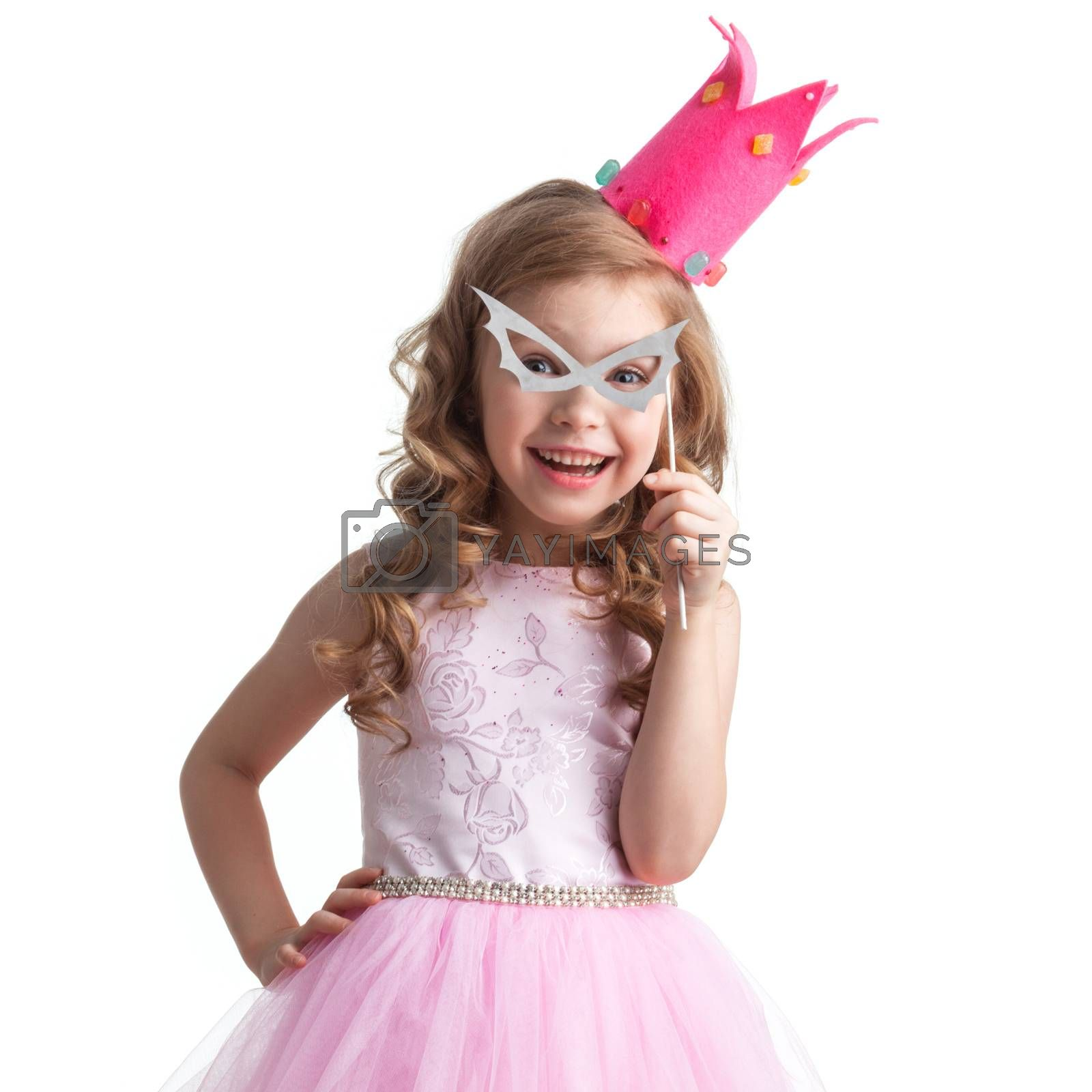 Funny princess girl in pink dress and crown holding party glasses on stick