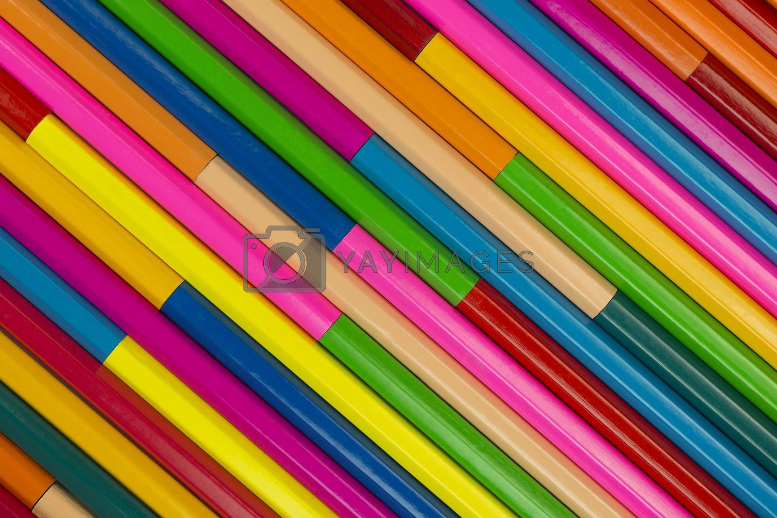 Collection of coloured pencils in a diagonal line pattern as background picture
