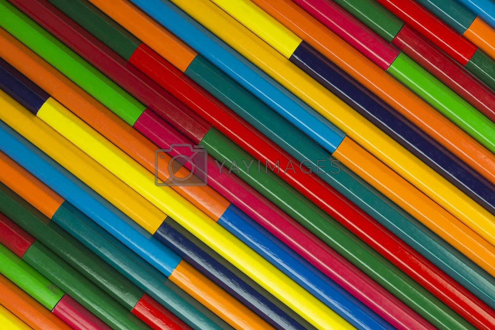 Collection of coloured pencils in a diagonal complementary colors set up as background picture