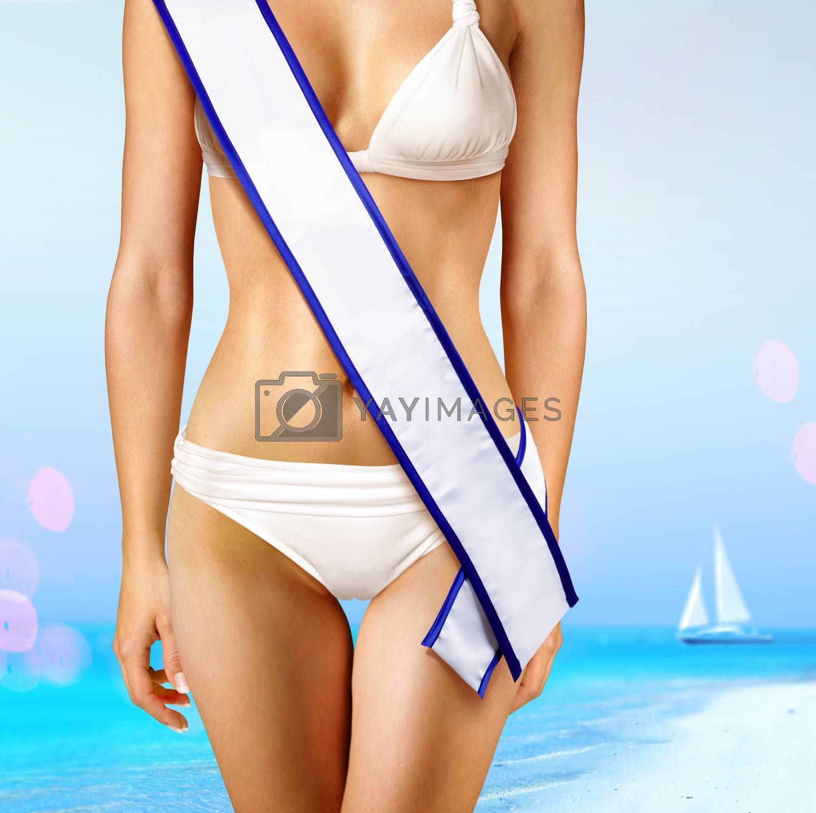 woman with white tape of beauty contest on beach