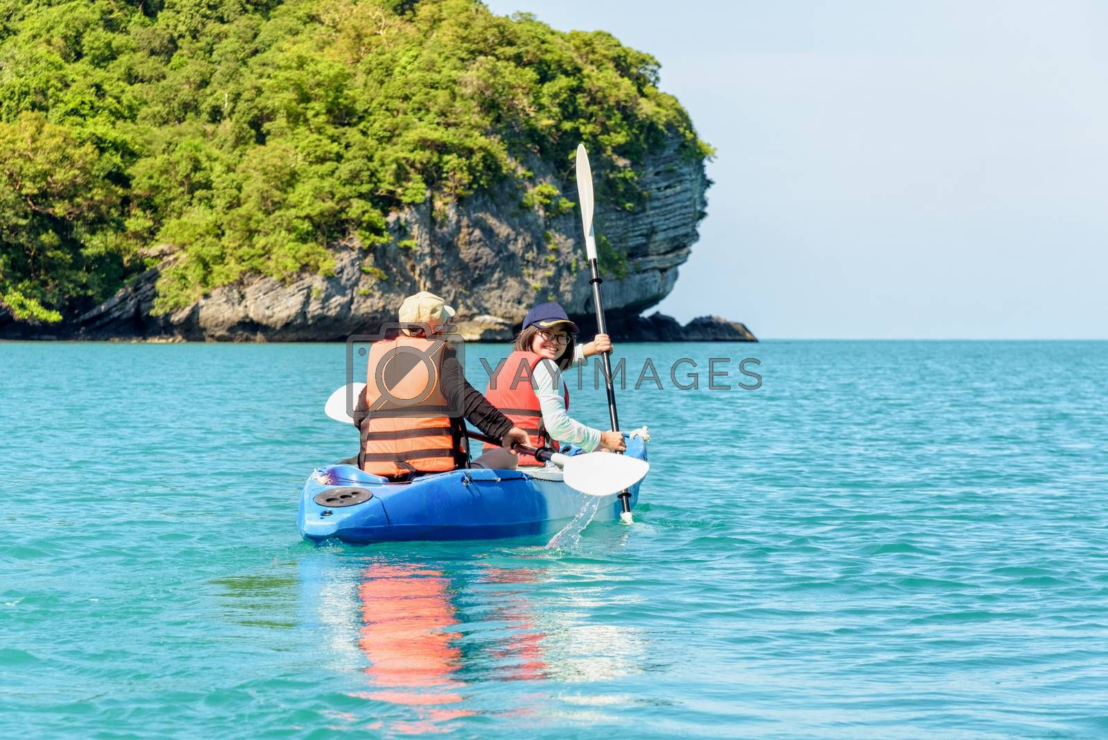 Two women are mother and daughter. Travel by boat with a kayak happy on the sea under the bright summer sky front of Ko Wua Ta lap islands at Mu Ko Ang Thong National Park, Surat Thani, Thailand