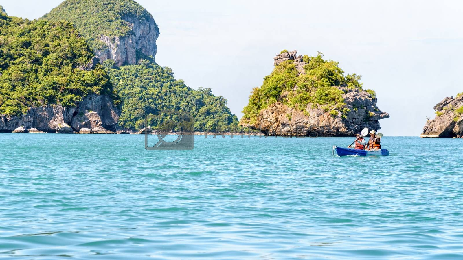 Two women are mother and daughter. Travel by boat with kayak view the beautiful natural landscape of the blue sea and island at summer, Mu Ko Ang Thong National Park, Surat Thani, Thailand, 16:9 widescreen