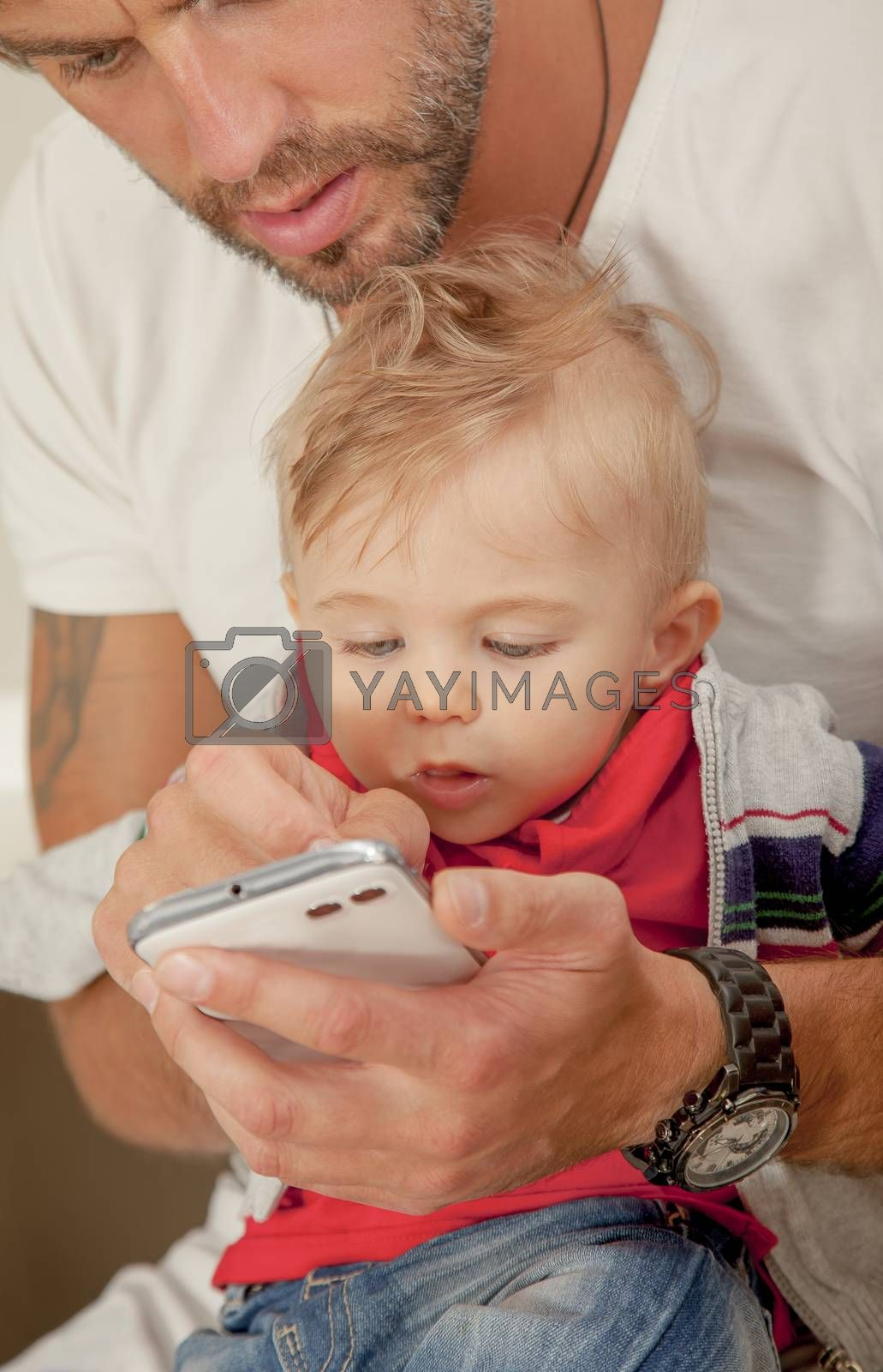 Royalty free image of Phone Baby Interest Technology Father Showing by vilevi