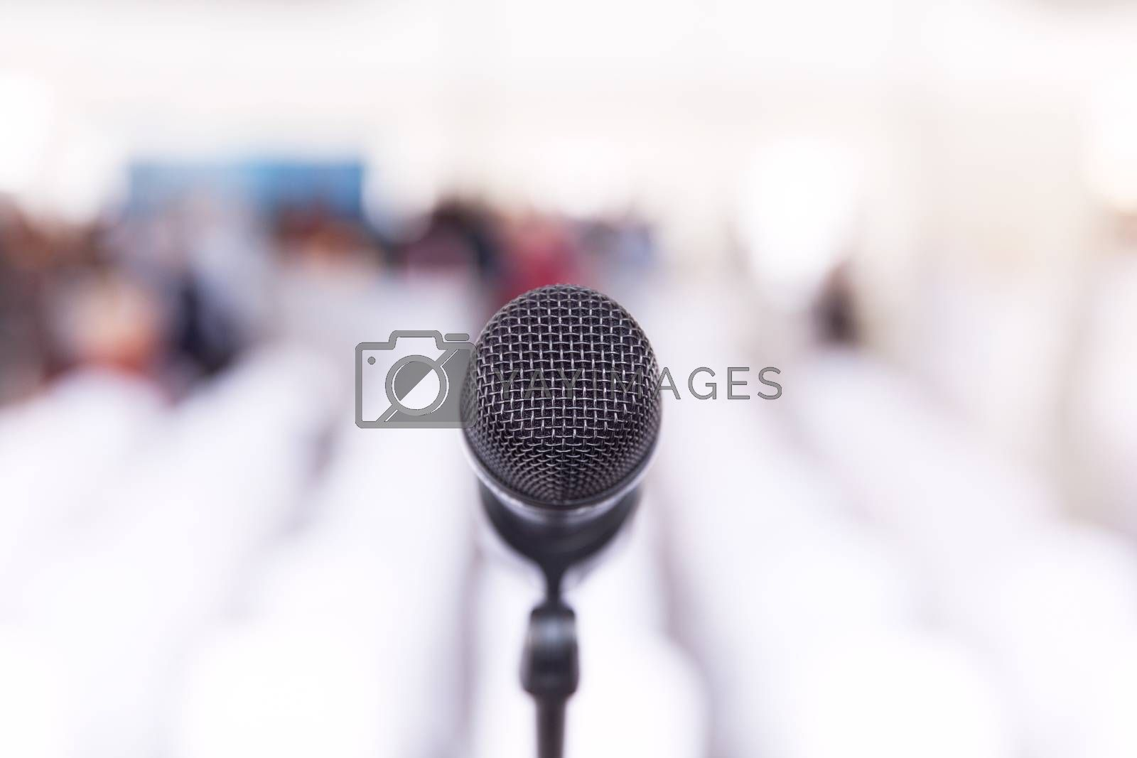 Microphone in focus, conference room without auditorium in the background