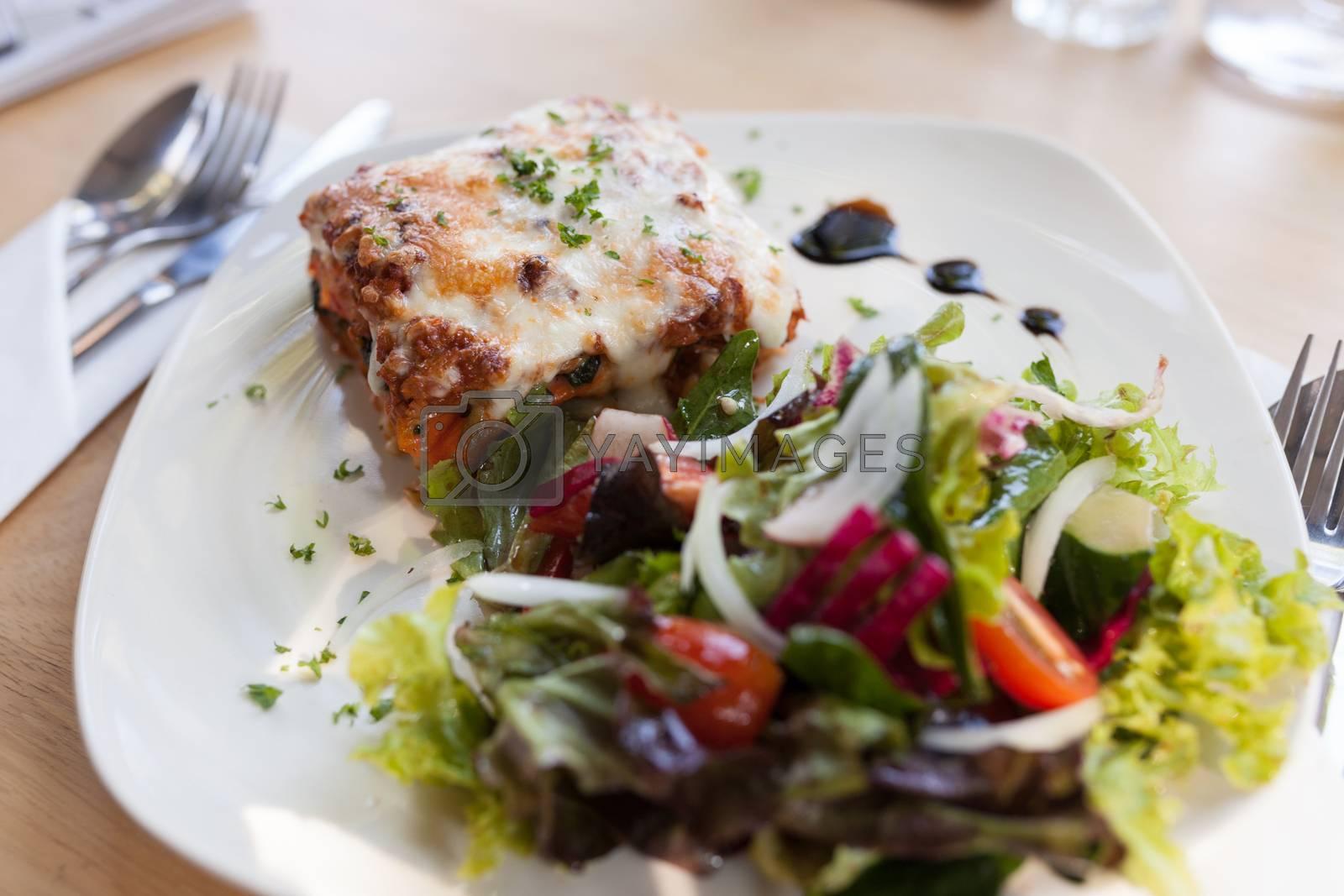 Authentic Italian Meat Lasagna with fresh salad.