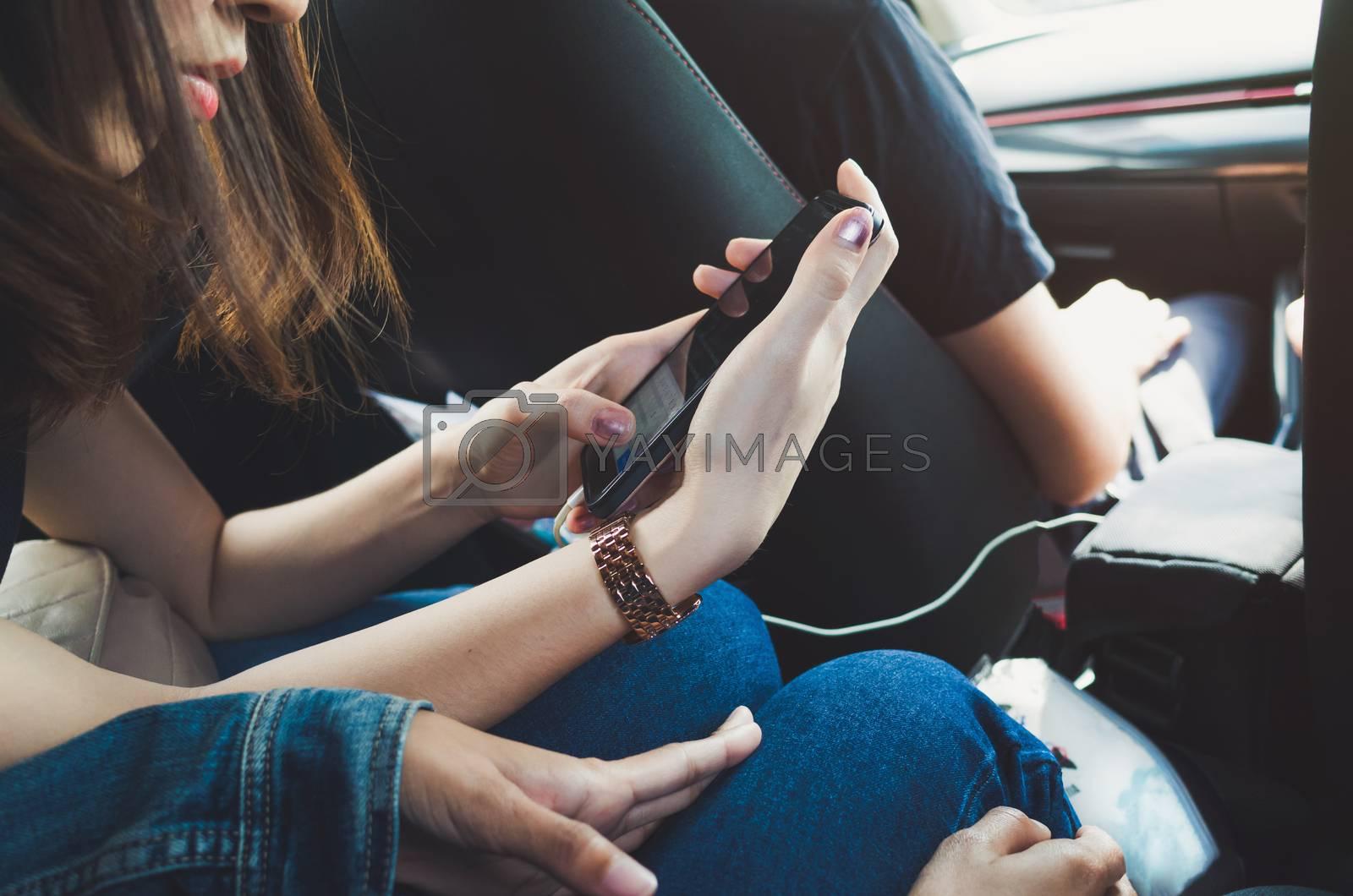 Women using phone in the car.