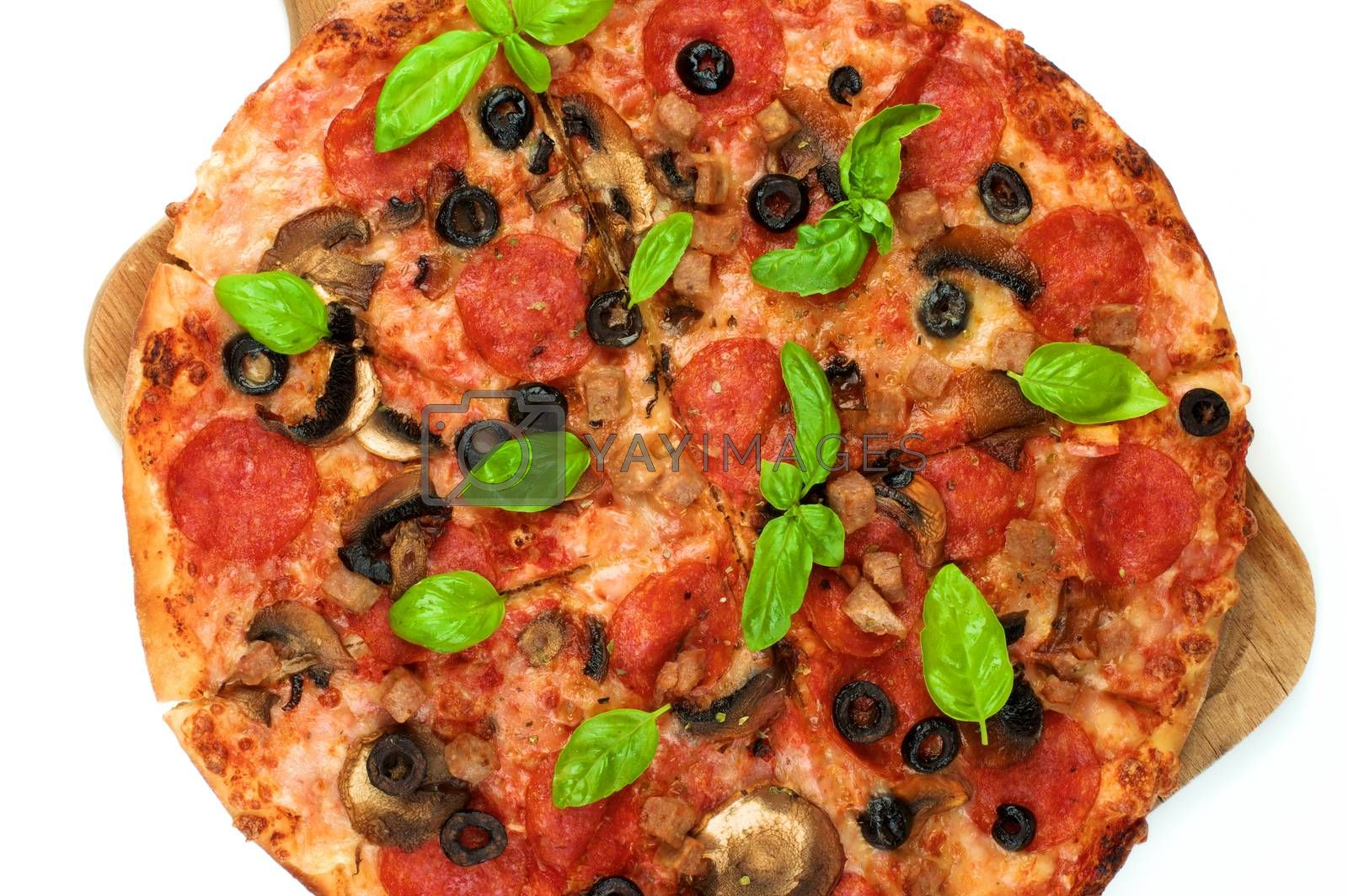 Homemade Pepperoni Pizza with Mushrooms, Black Olives, Ham and Basil on Wooden Board Cross Section on White background