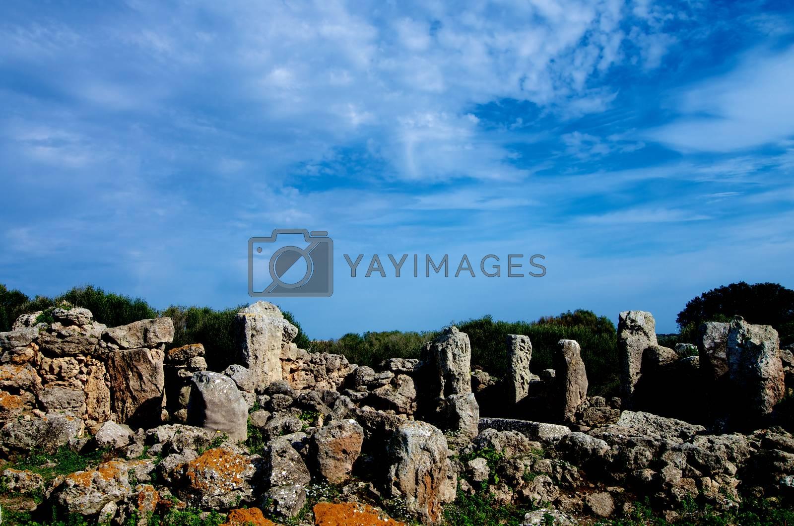 Ancient Megaliths Talaiot Settlement of So na Cacana against Blue Sky Outdoors. Menorca, Balearic Islands