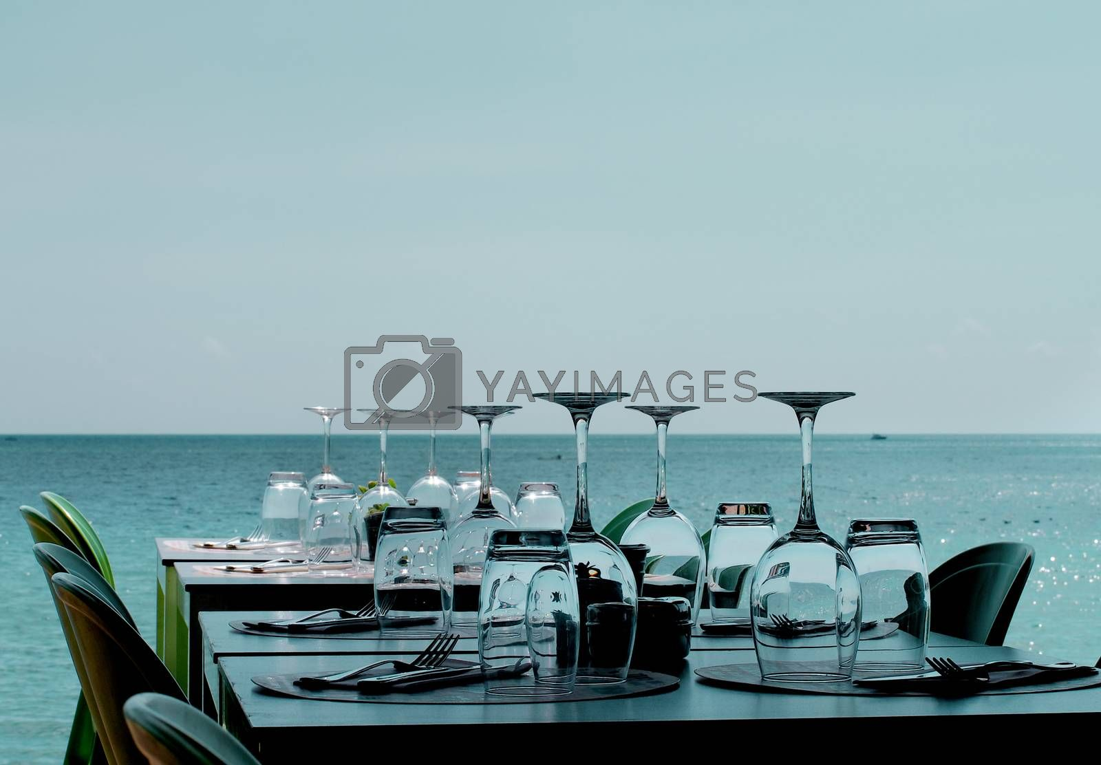 Served Restaurant Tables on Sea Coast by zhekos