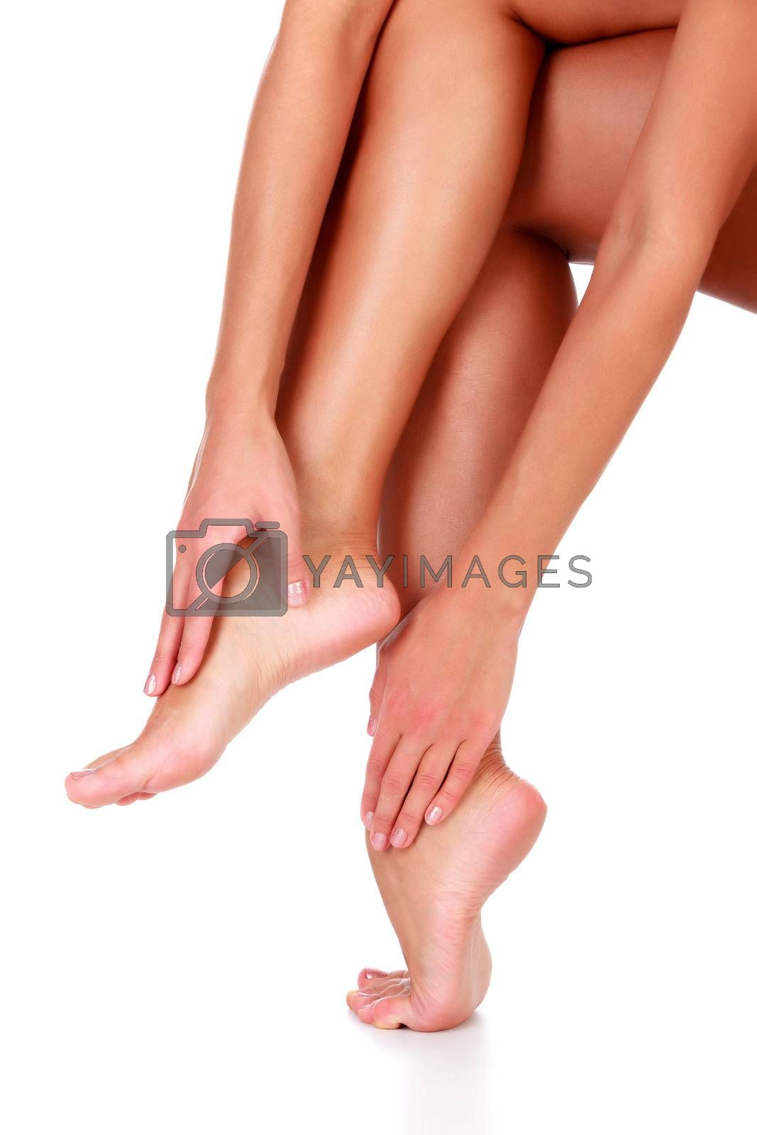 Closeup shot of healthy legs of beautiful woman, isolated on white background