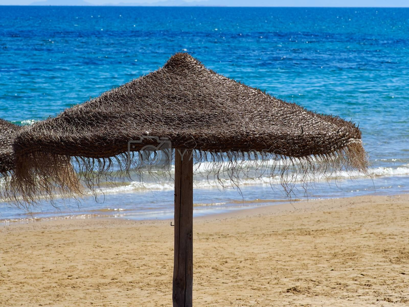 Sunshade on a Tropical  exotic beach great summer vacation image