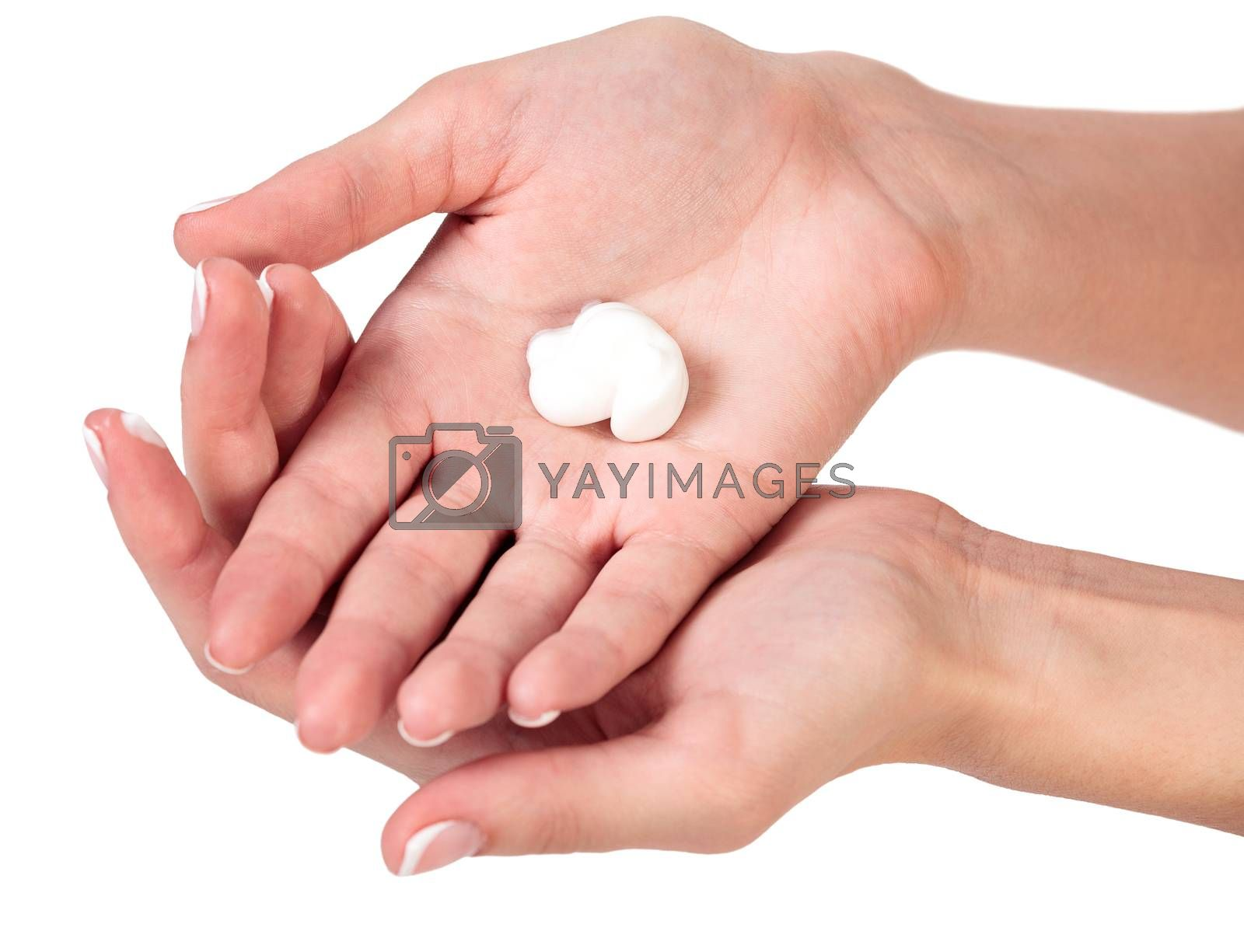 Closeup shot of beautiful woman's hands with cream, isolated on white background