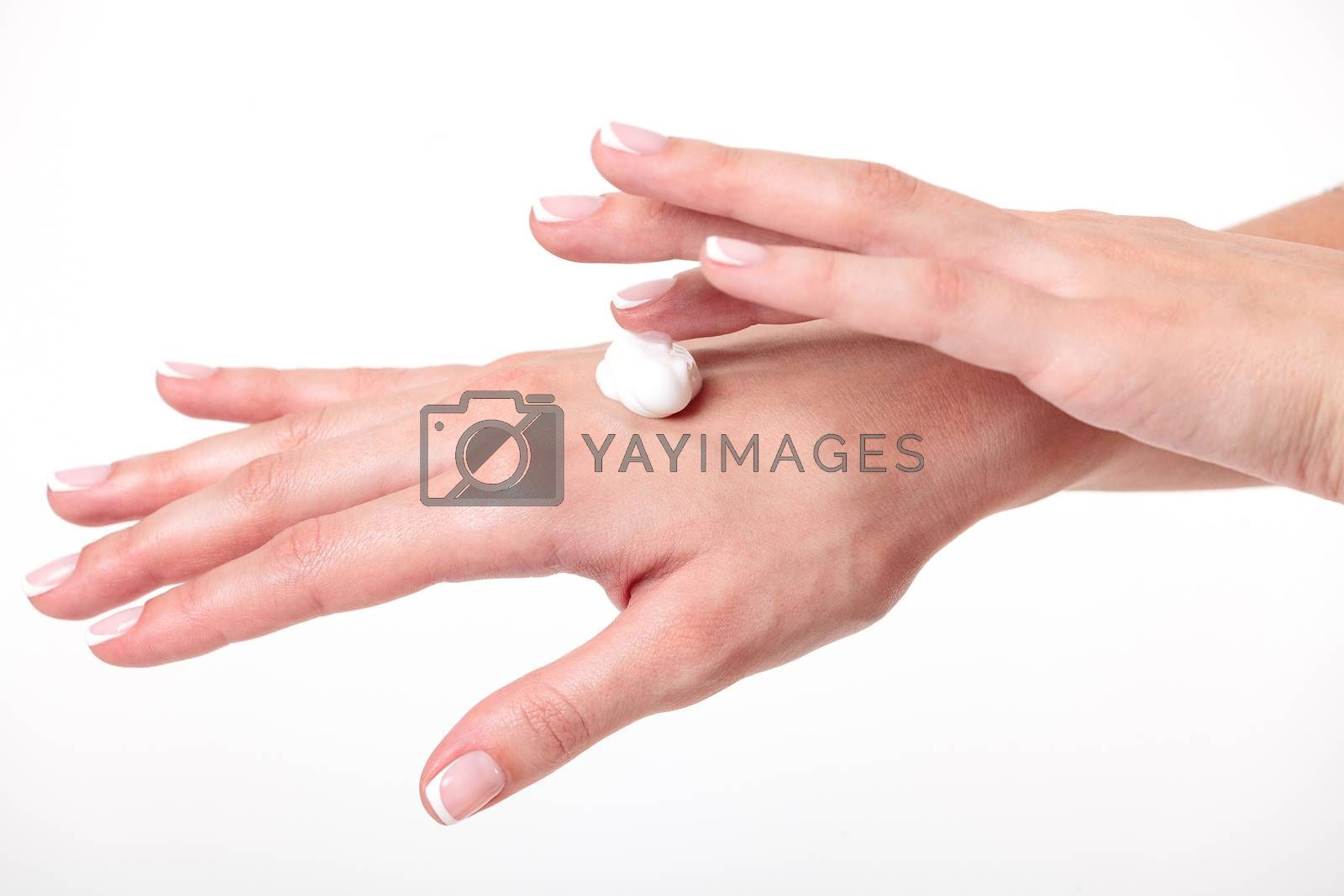Closeup shot of beautiful woman's hands with cream, white background