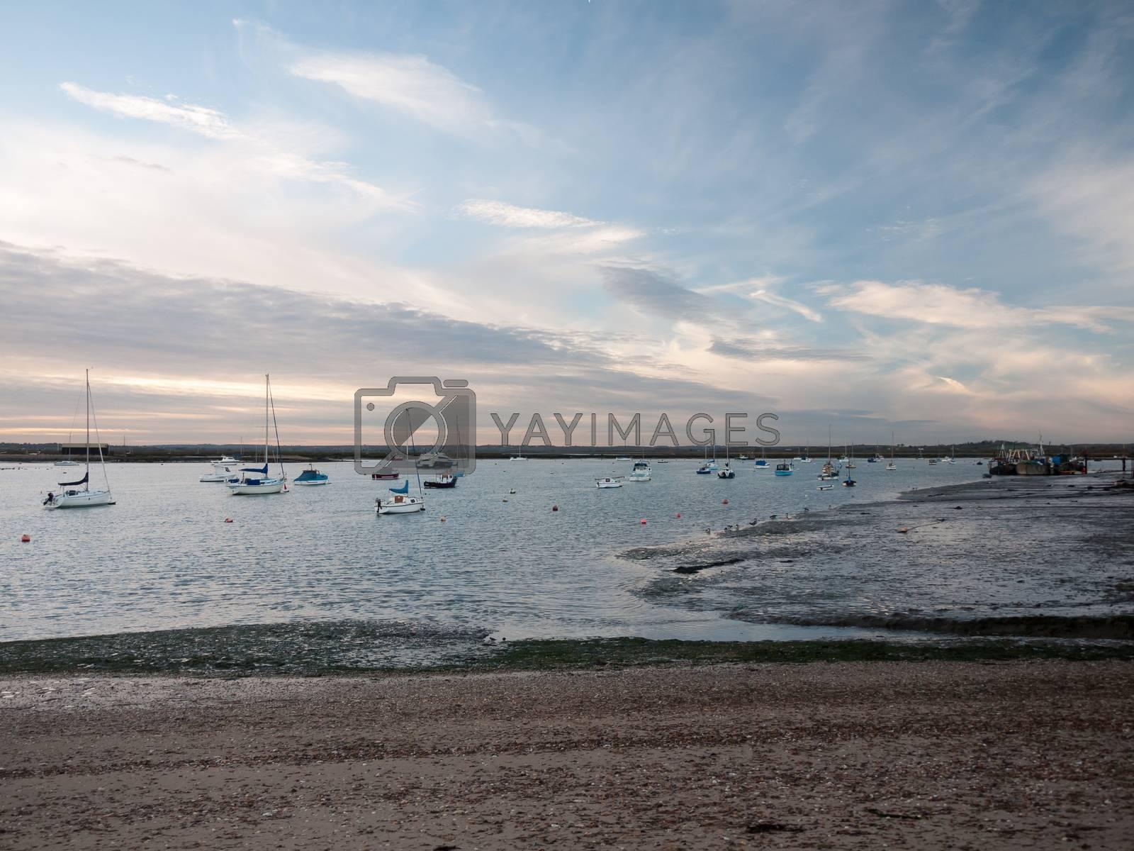 marina harbour landscape beach ocean sky with moored boats; west mersea, essex, england, uk