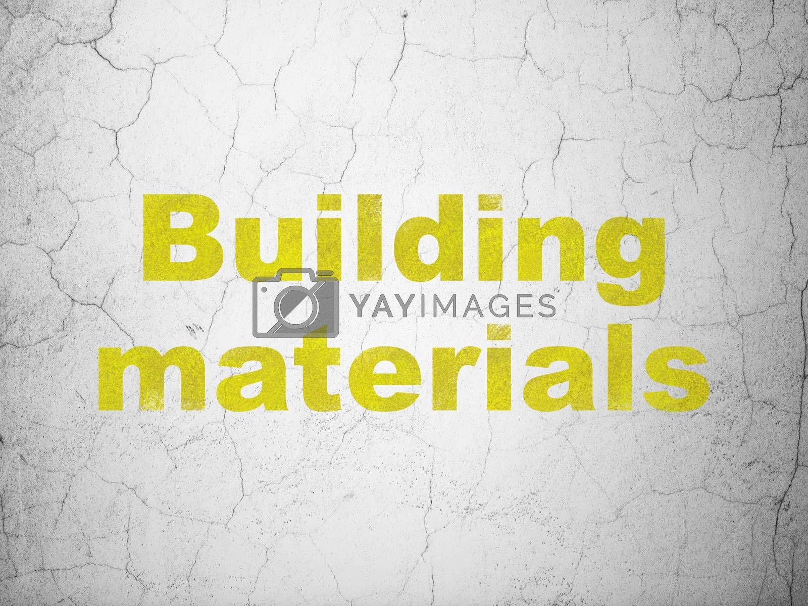 Construction concept: Yellow Building Materials on textured concrete wall background