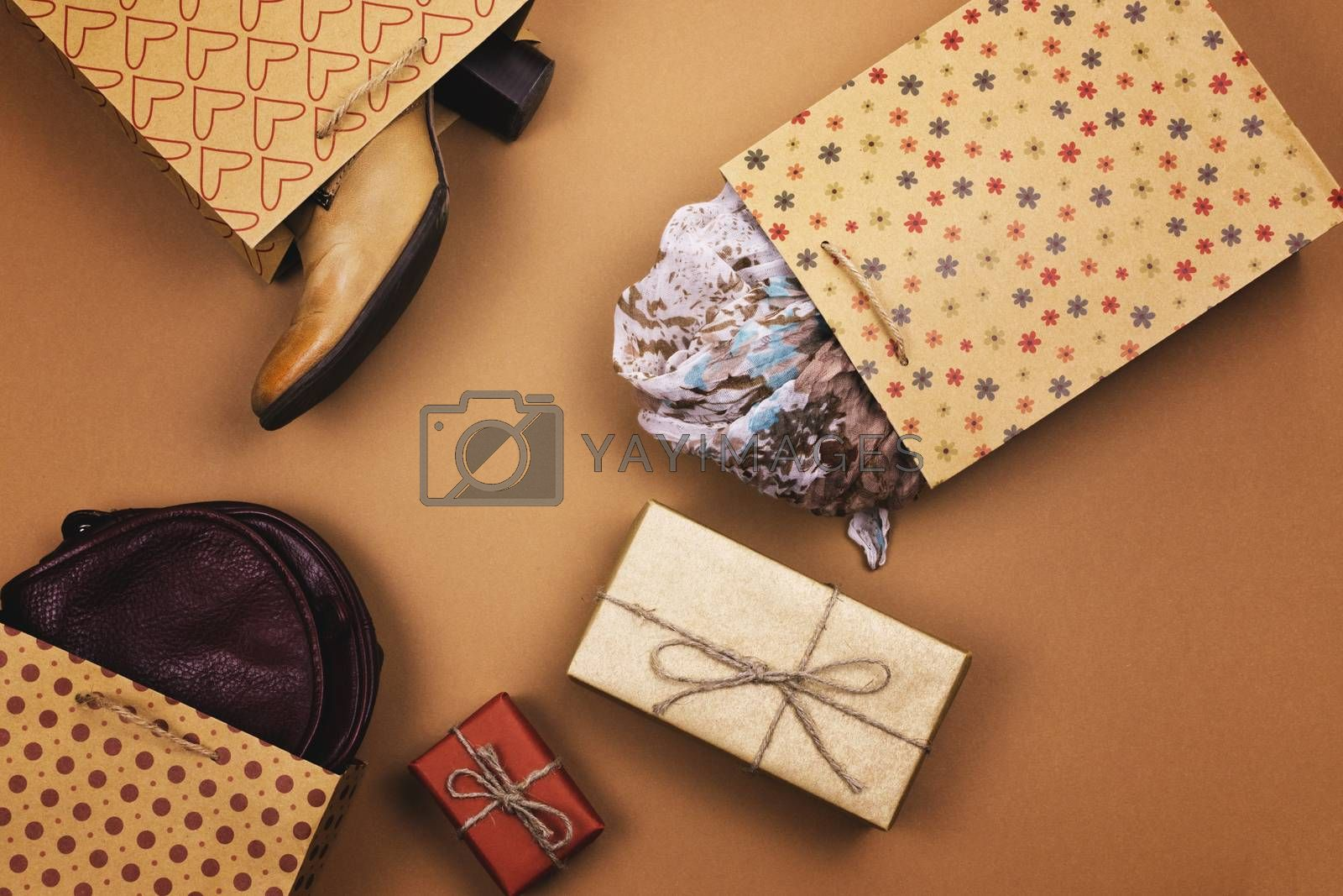 Gifts in packages on a brown background