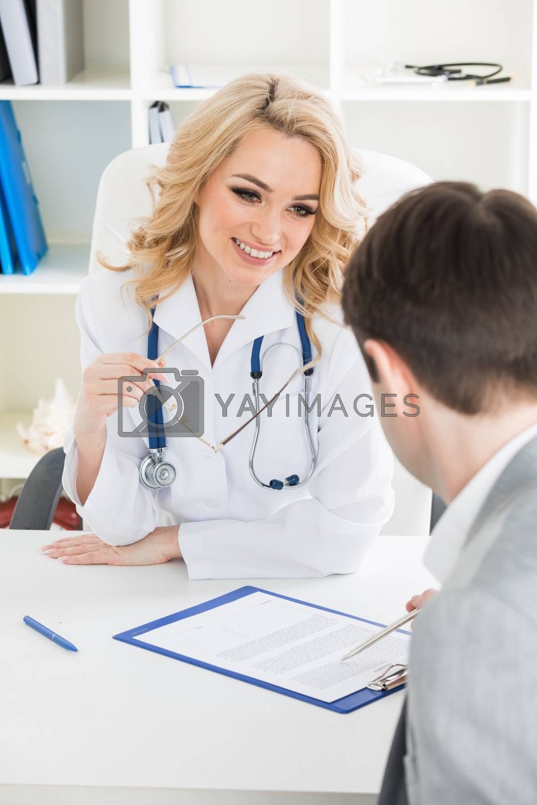 Doctor consulting patient in a clinical office