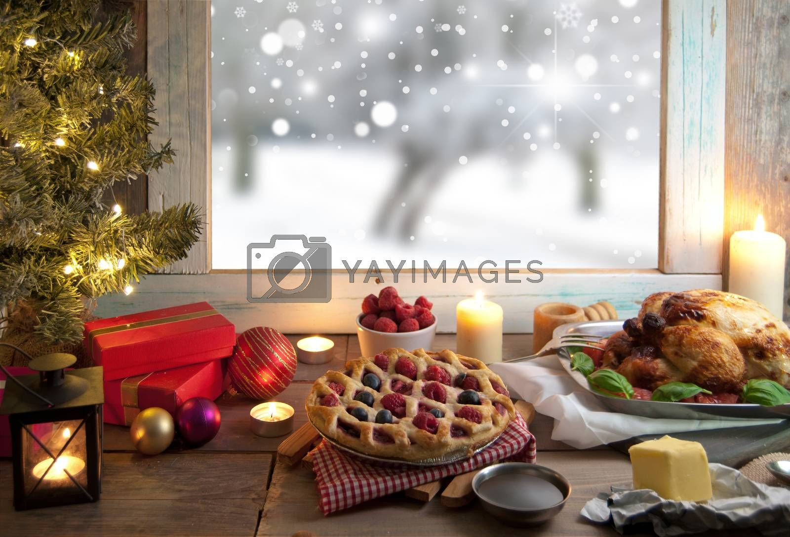 Christmas roast meal setting with winter snow through a window