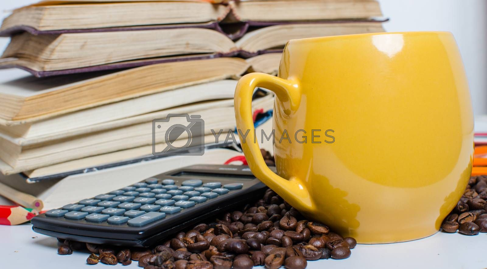 Pile of books,calculator and coffee by noskaphoto