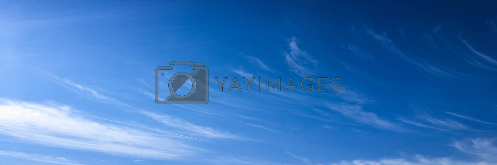 Beautiful blue sky with clouds background. Sky with clouds weather nature cloud blue. Blue sky with clouds and sun. by titco