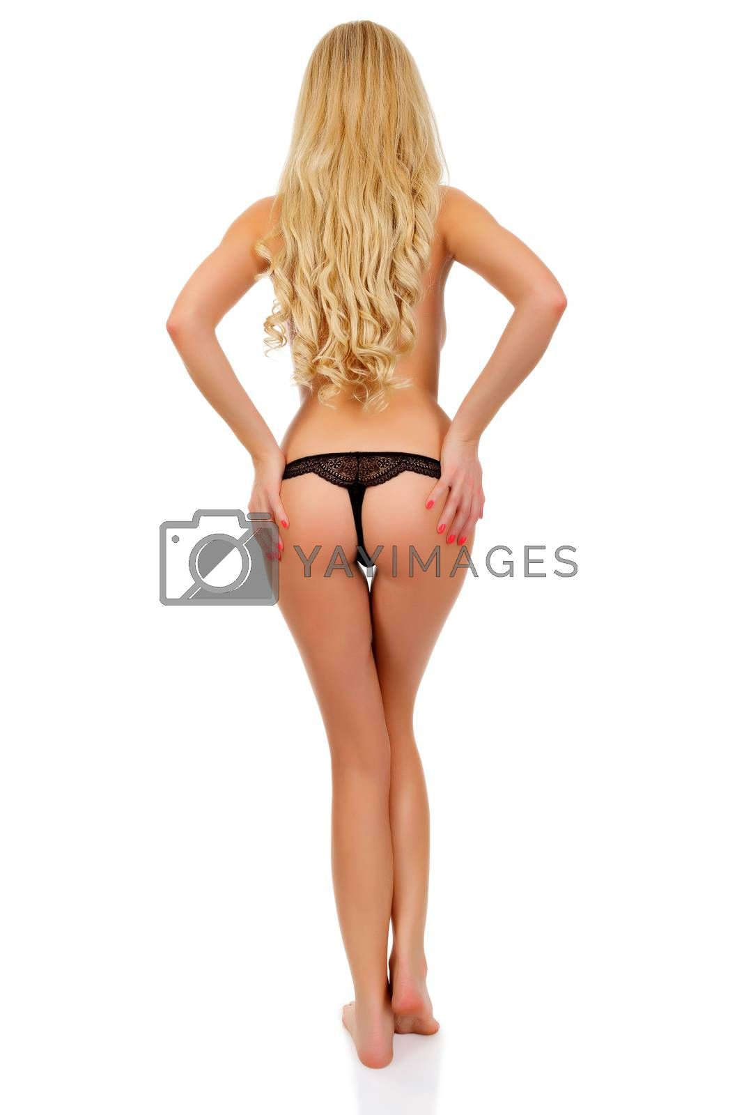 Sexy woman with long blond hair posing, isolated on white background