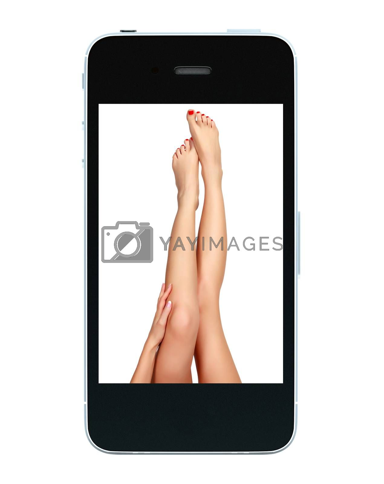 Beautiful female legs on a screen of black smartphone, isolated on white background