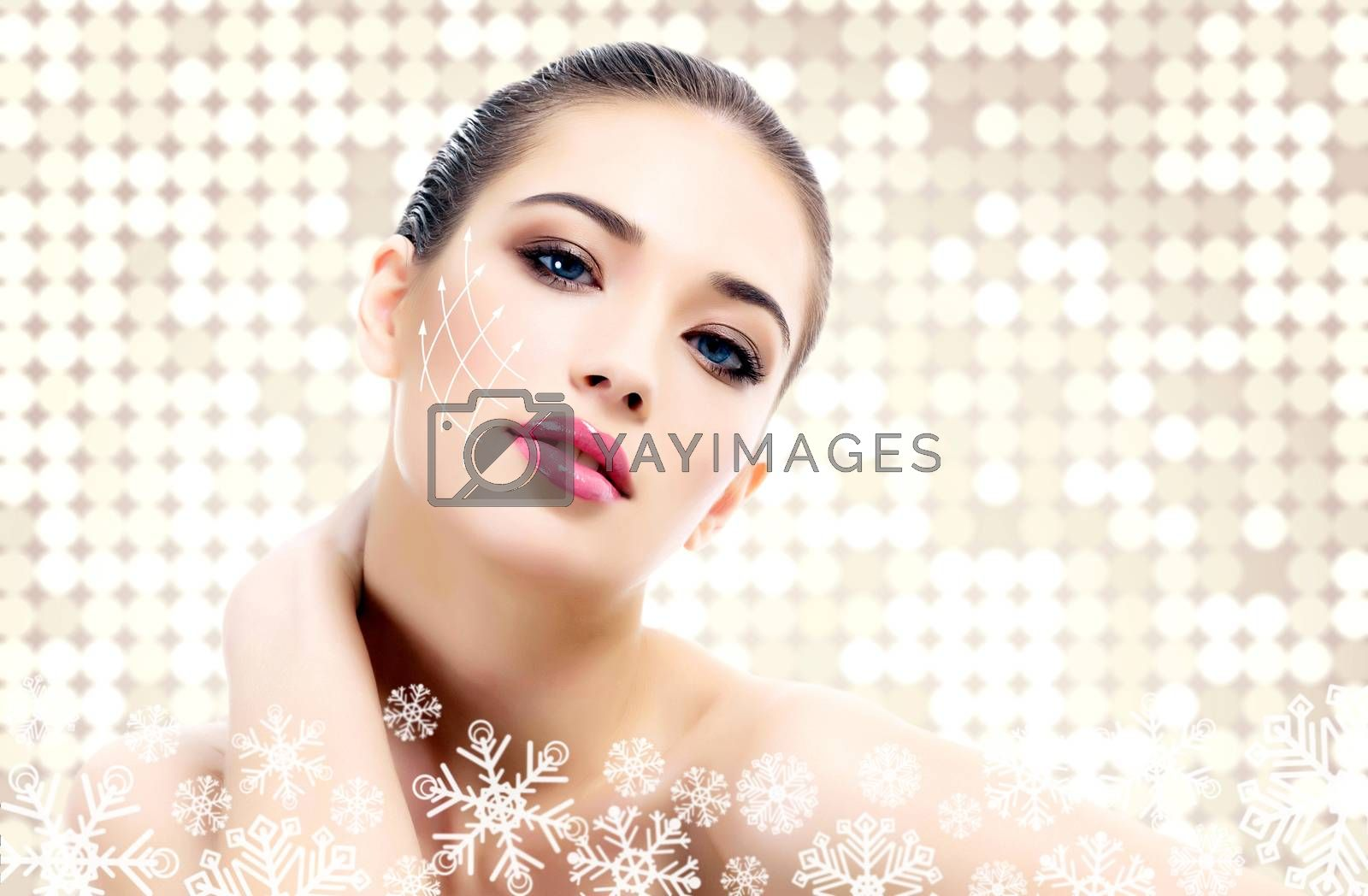 Young beautiful woman with clean fresh skin, abstract background with snowflakes