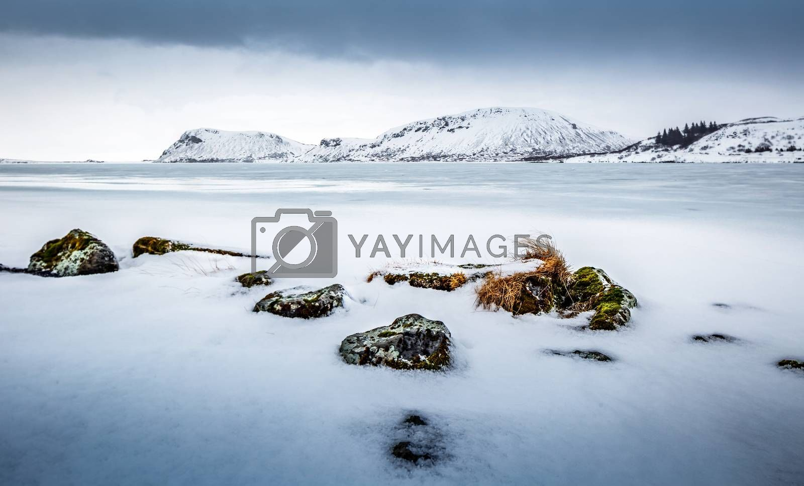 Beautiful winter landscape, amazing view on the frozen lake covered with white clean snow, cold but wonderful weather, Iceland, Scandinavia
