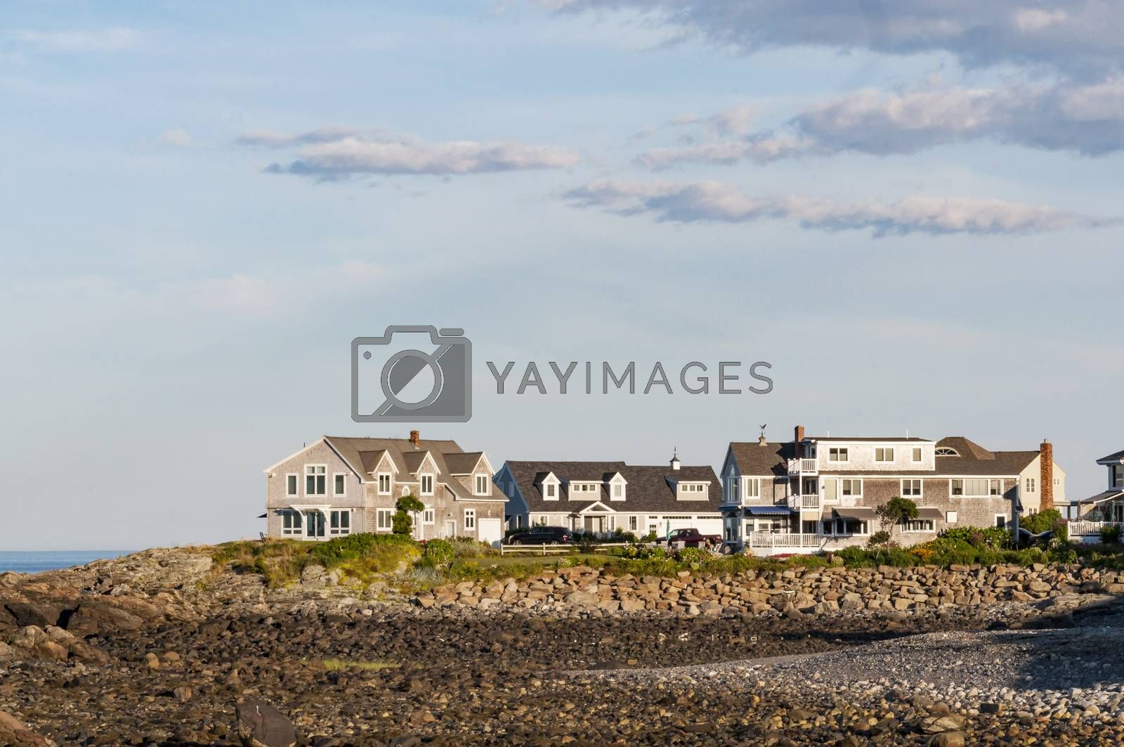 Houses near the coastline with blue and clean sky in Maine, USA