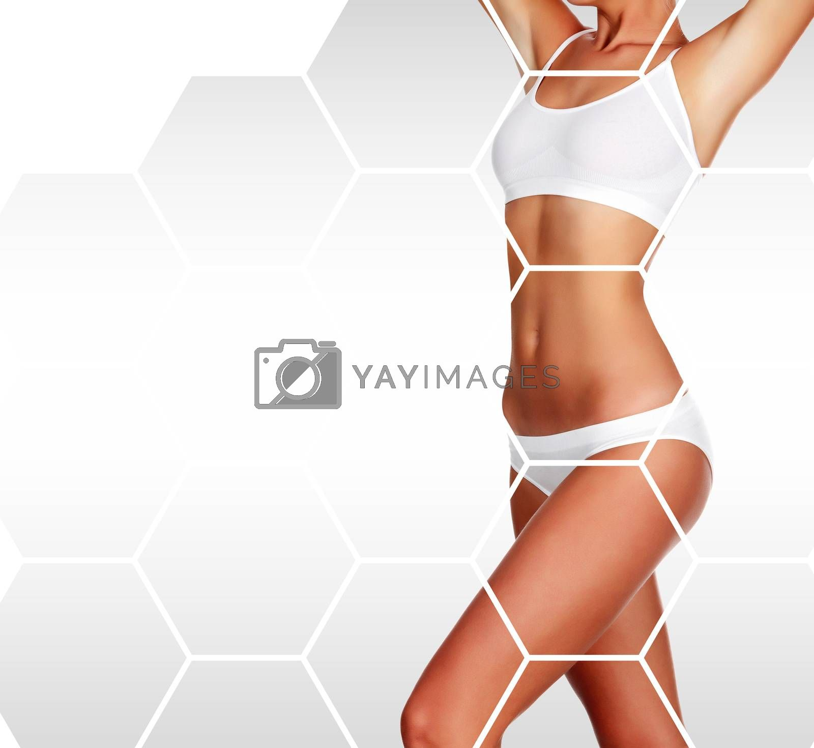 Beautiful woman's body against a grey background with copyspace, body care concept