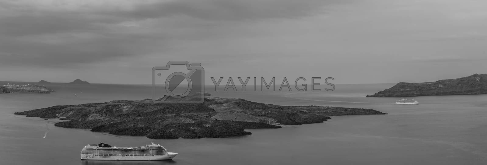 cruise ships near an island in the sea panorama view black and white
